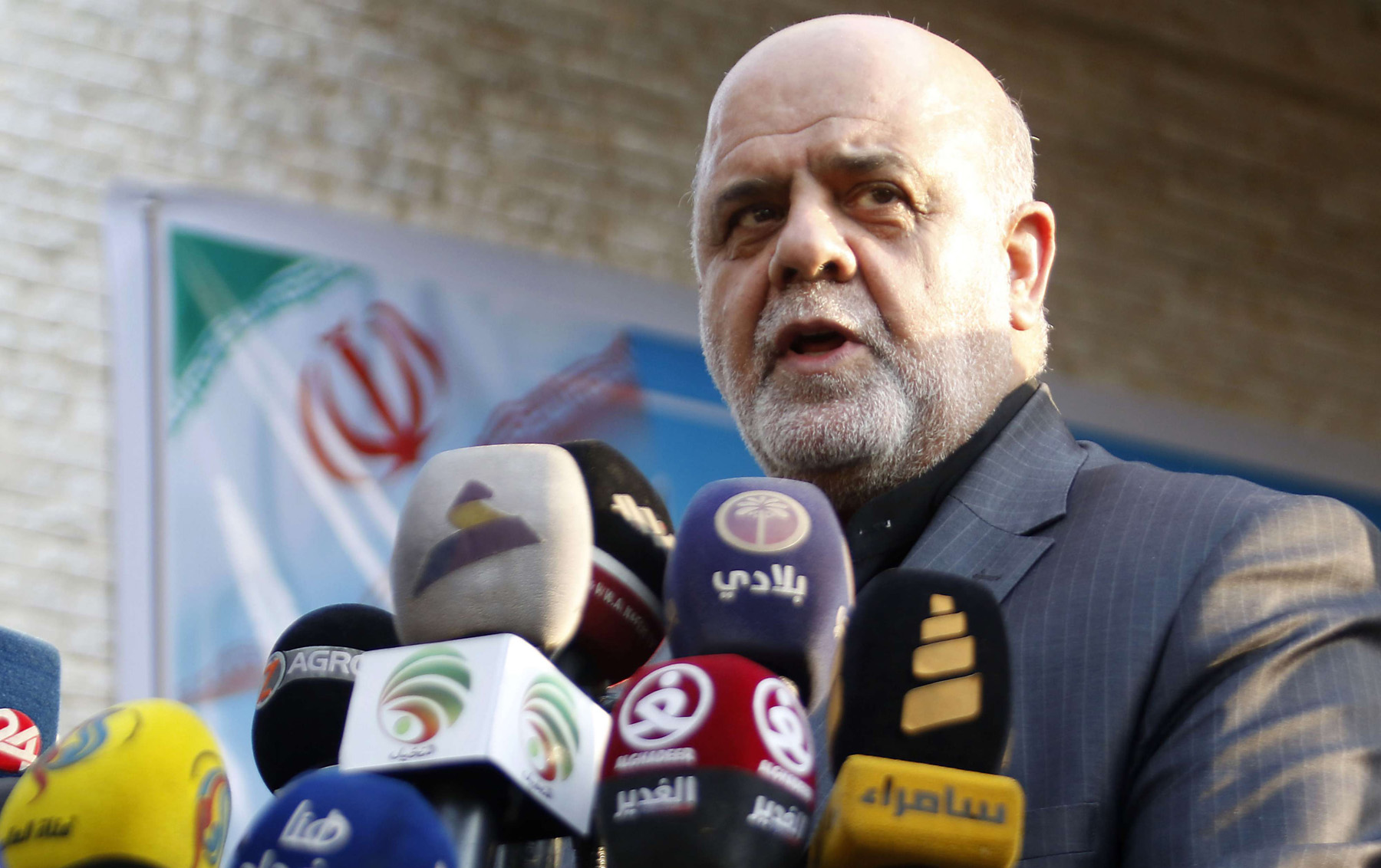 Iranian Ambassador in Iraq Iraj Masjedi speaks outside the new building of the Iranian Consulate in Basra, on September 11. (AFP)