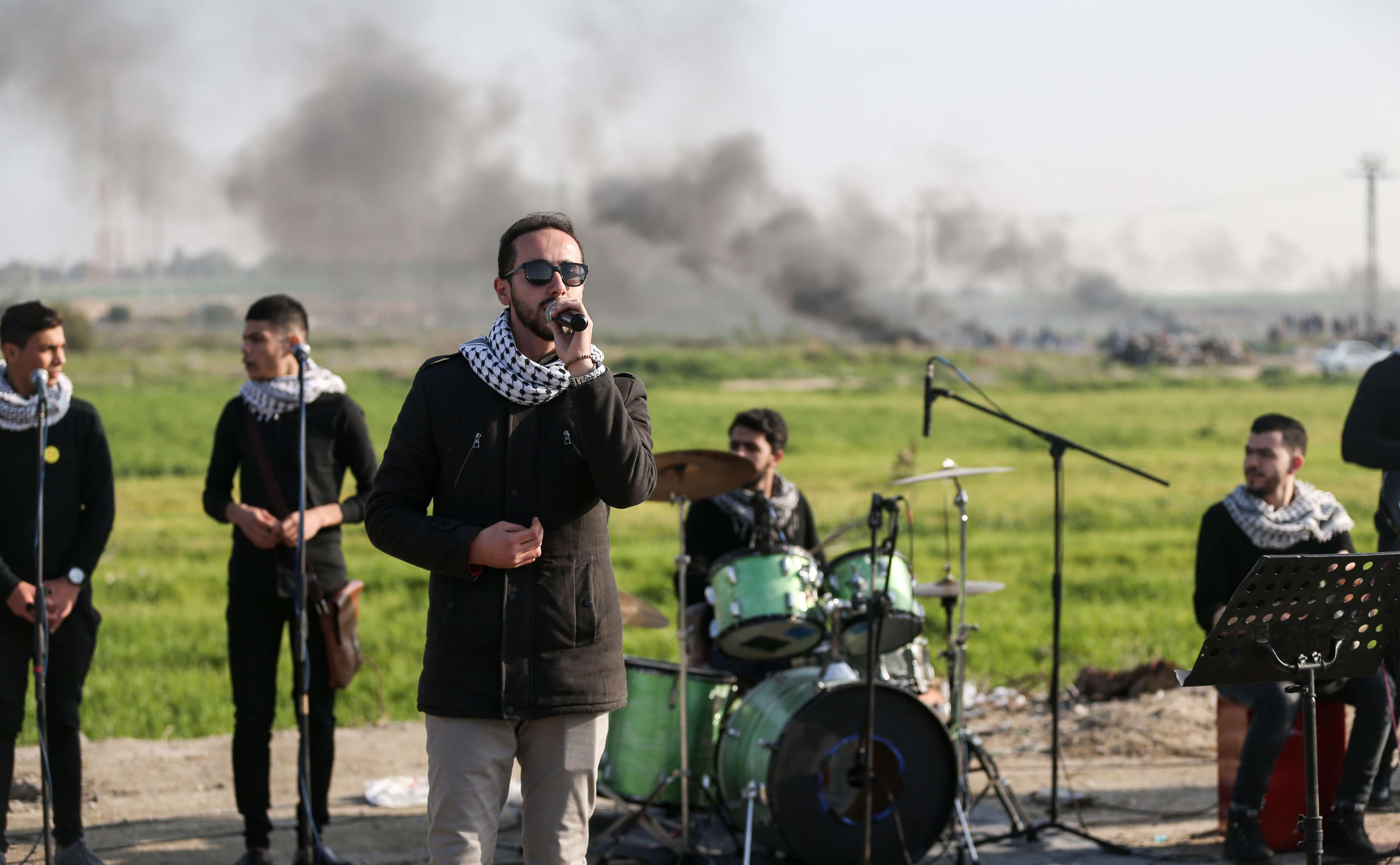 A Palestinian band performs a concert during clashes near the border with Israel, last February.(AFP)