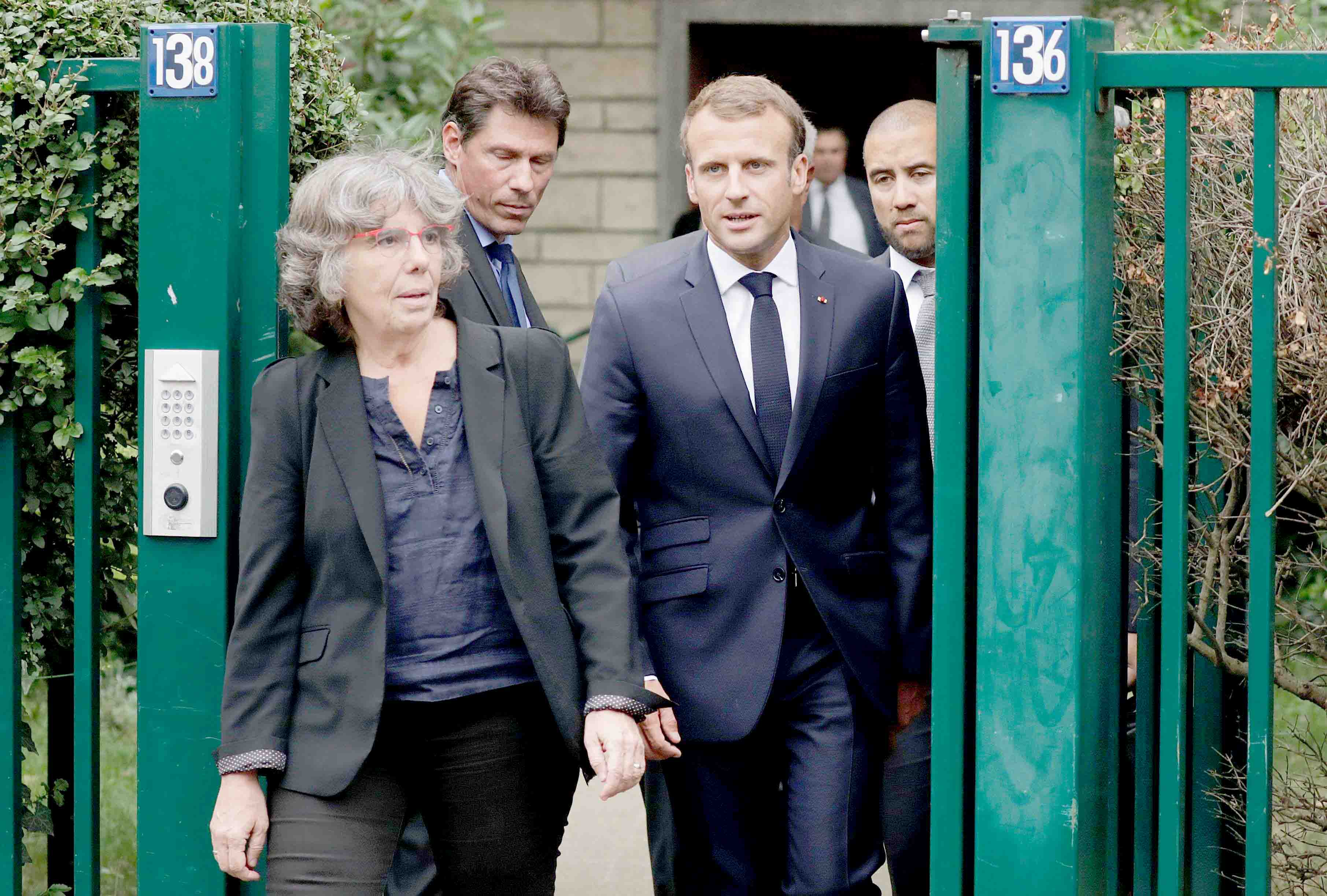 French President Emmanuel Macron (C) walks next to Michele Audin, daughter of late Maurice Audin, as he leaves the home of Josette Audin, widow of Audin in Bagnolet, on September 13. (AFP)