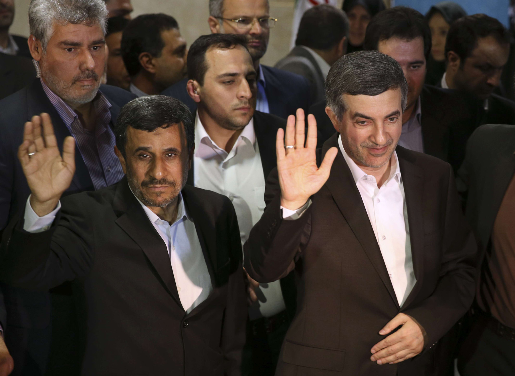 A 2013 file picture shows former Iranian President Mahmoud Ahmadinejad (L) and his close ally Esfandiar Rahim Mashaei in Tehran.                                                                                  (AP)