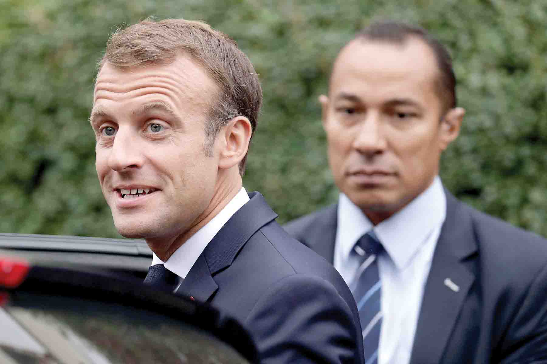 French President Emmanuel Macron leaves the home of Josette Audin, widow of Maurice Audin, in Bagnolet, on September 13. (AFP)