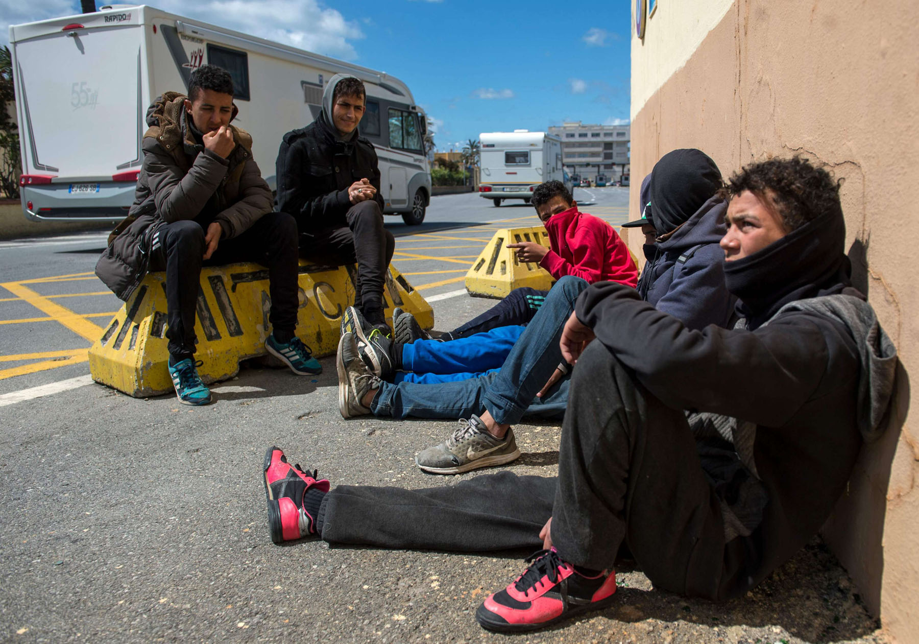 Young Moroccans gather at the harbour of the port city of Ceuta as they wait for the opportunity to board a boat for Europe. (AFP)