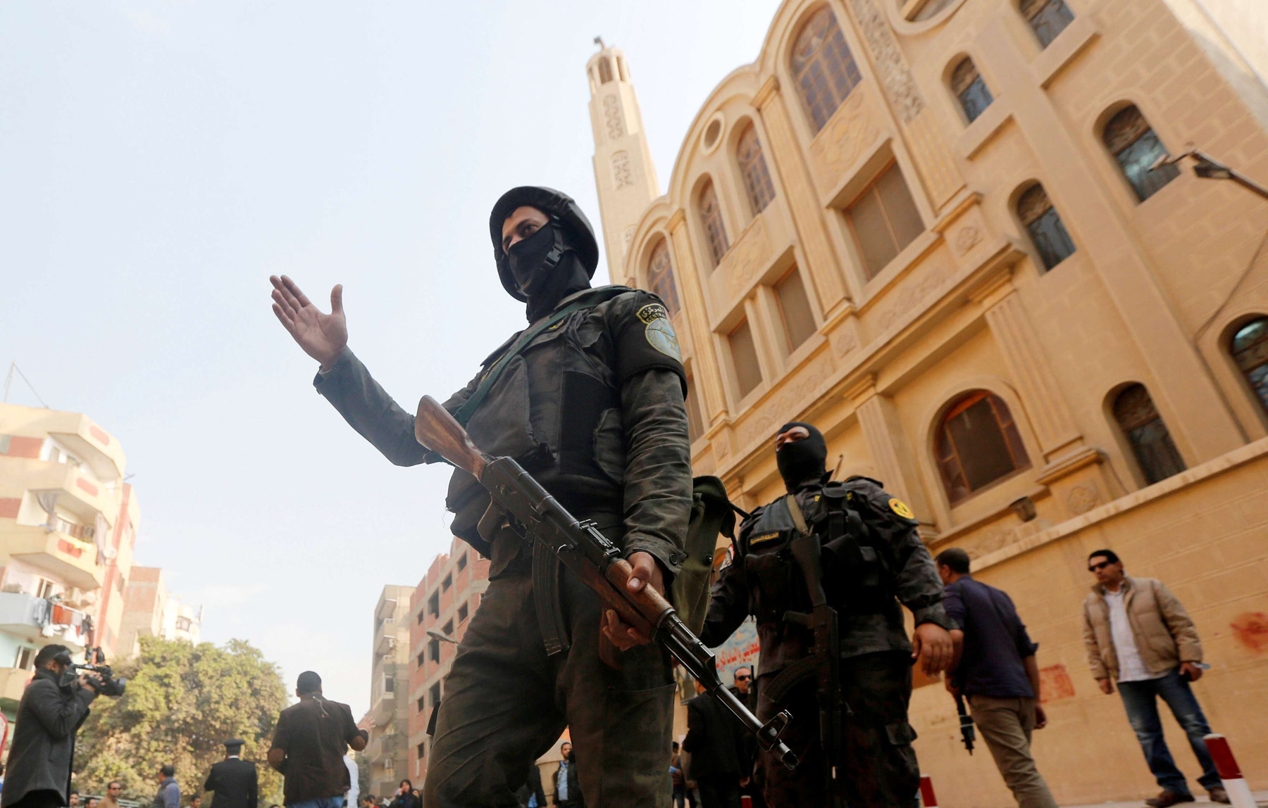 Security forces stand guard in Helwan district on the outskirts of Cairo. 	              (Reuters)