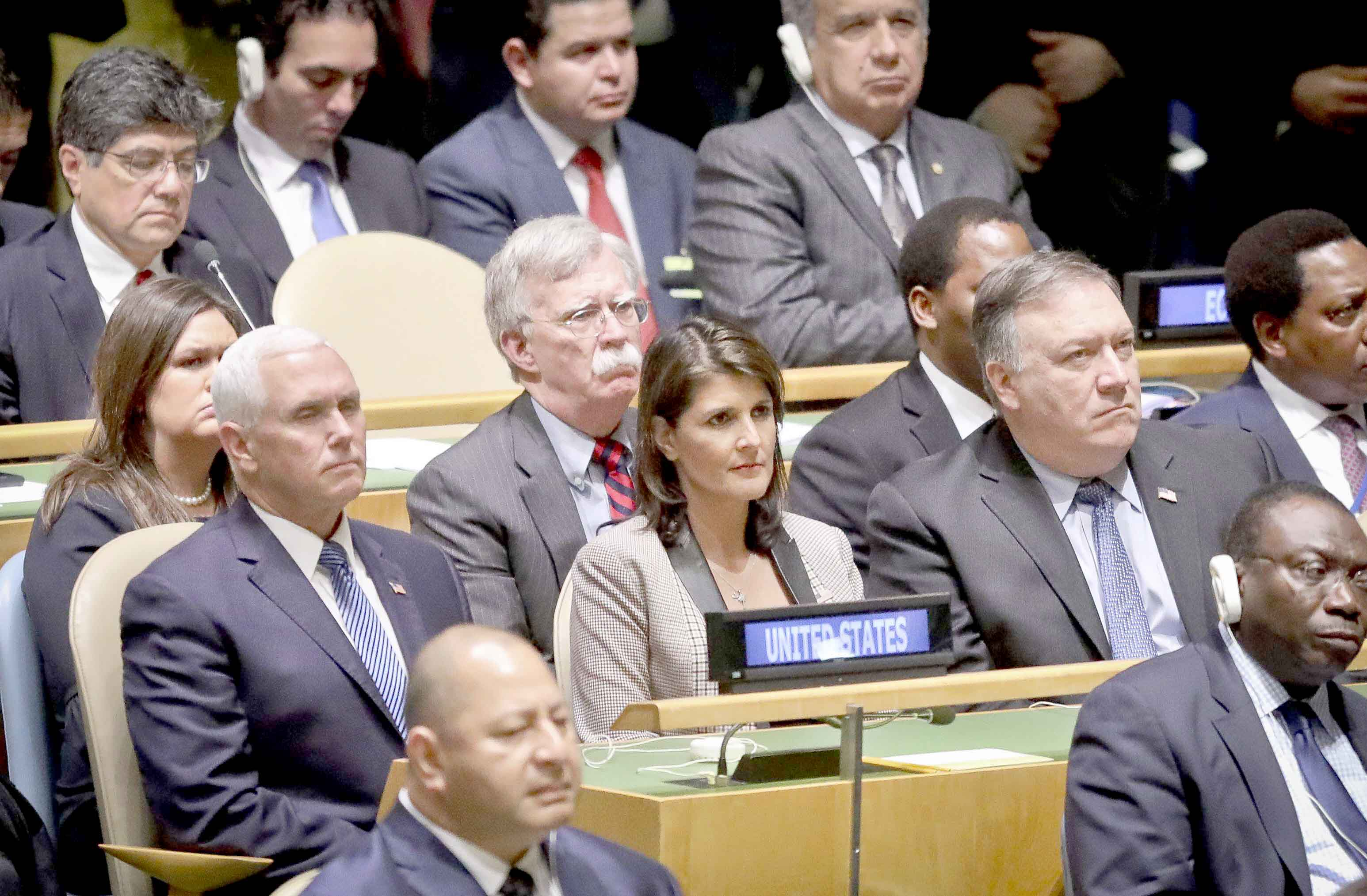 Members of the US delegation listen as President Donald Trump addresses the United Nations General Assembly, on September 25. (AP)
