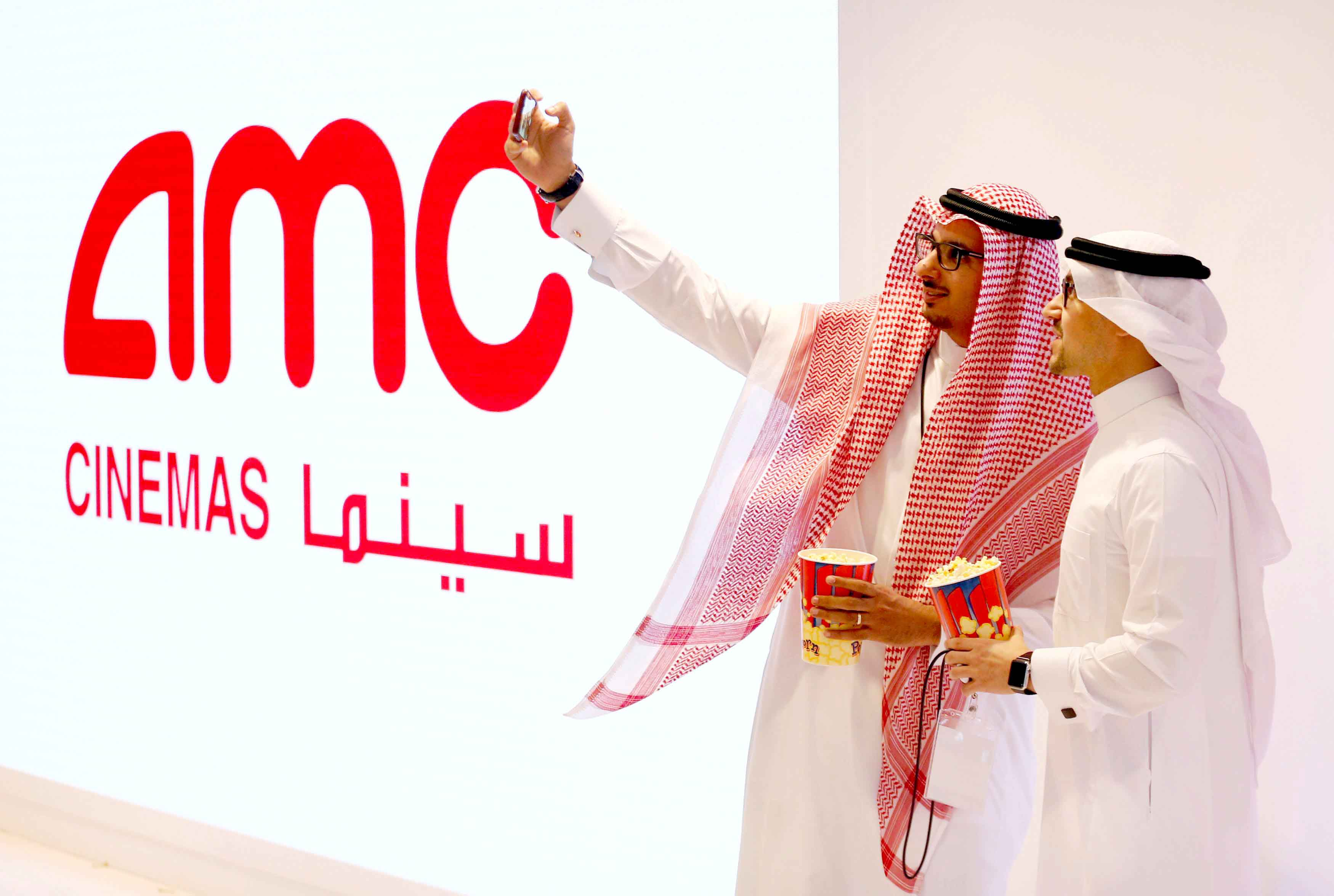 Two Saudi men take a selfie at a commercial movie theatre in Riyadh. (Reuters)