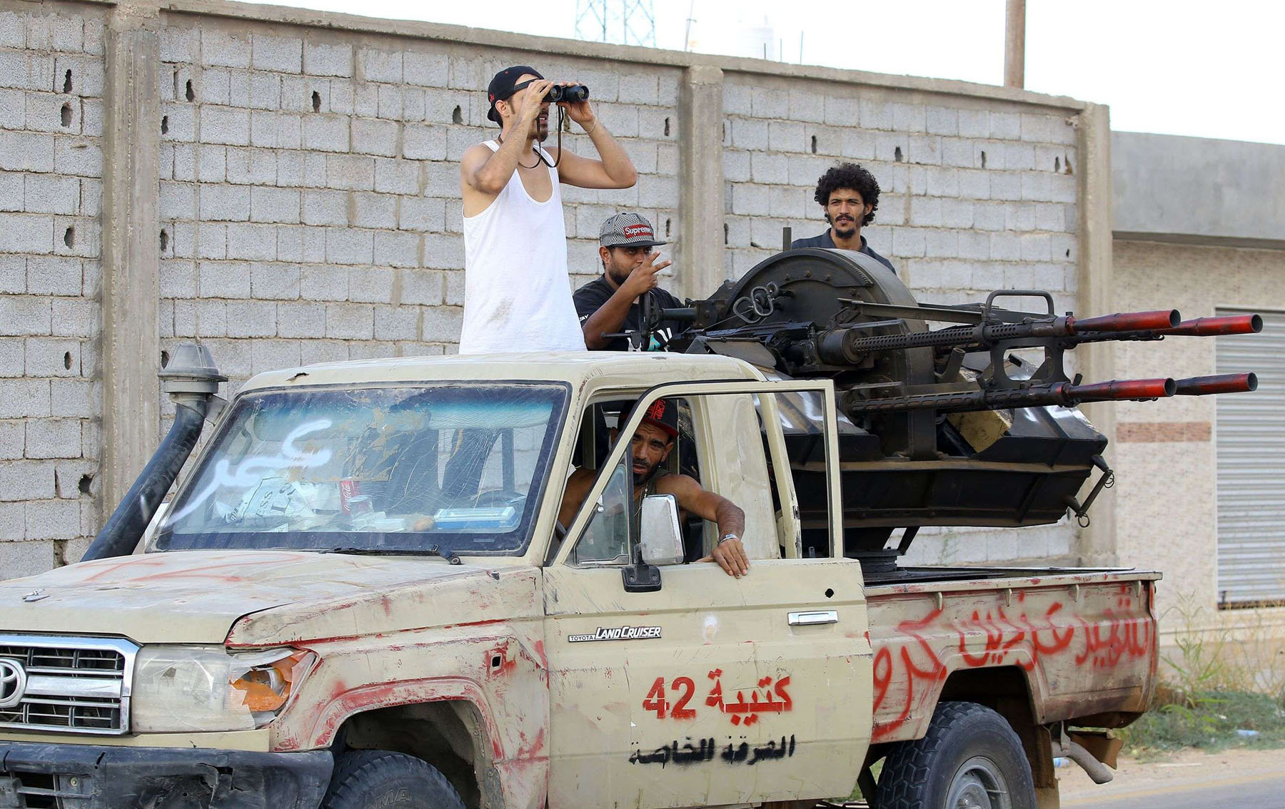 Libyan militiamen loyal to the Government of National Accord keep watch from a position south of Tripoli, on September 25.							    (AFP)