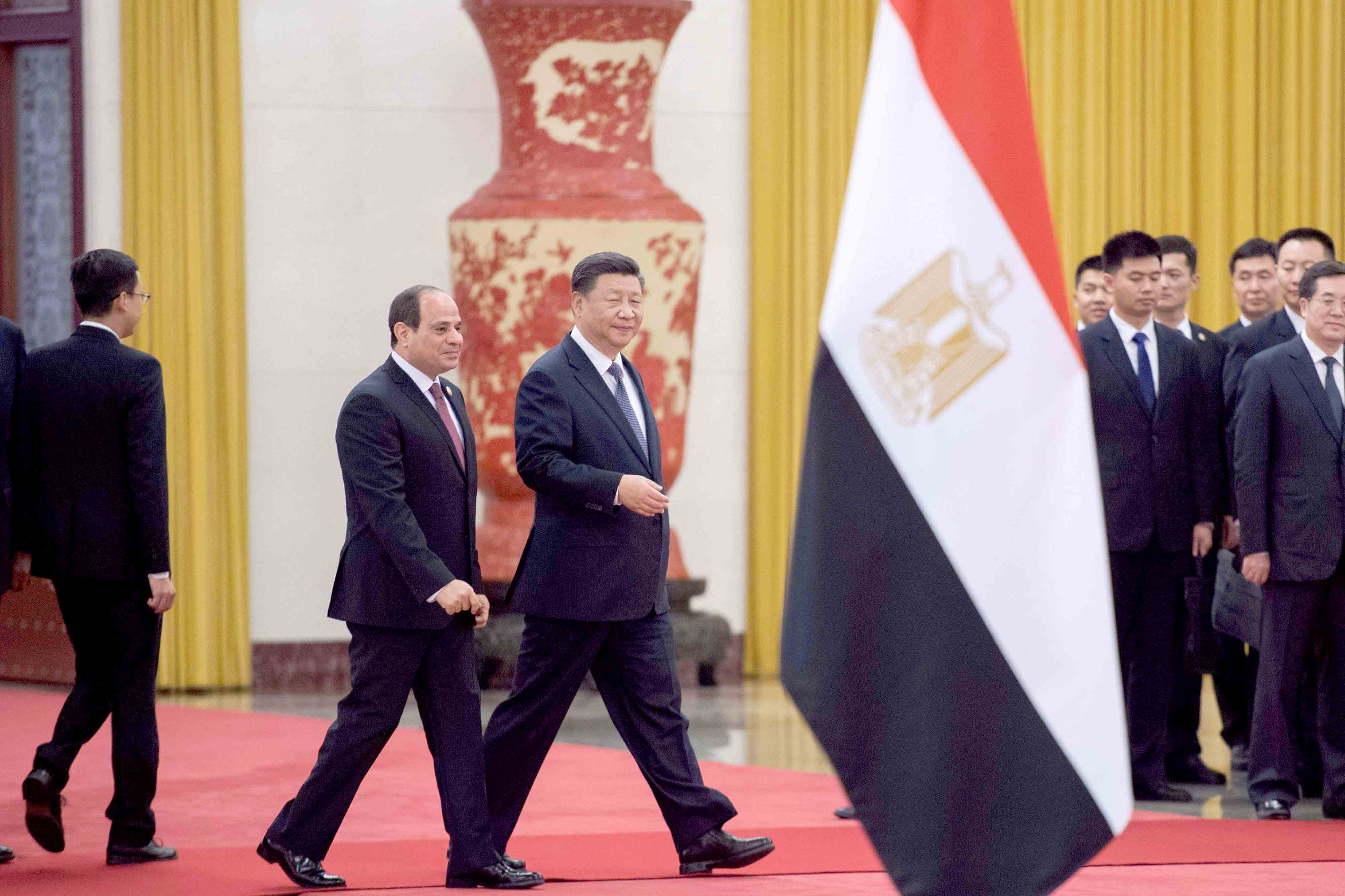 Diversifying partnerships. China's President Xi Jinping (R) and his Egyptian counterpart Abdel Fattah al-Sisi (C) walk during a welcoming ceremony in Beijing, on September 1.(AFP)
