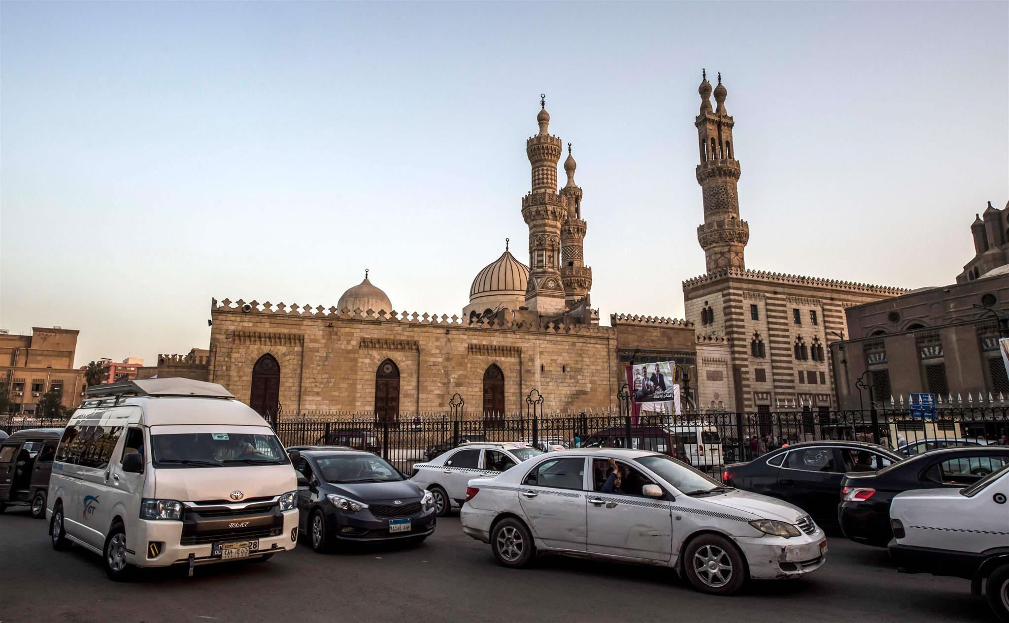 Hurdles to Reform? Vehicles drive past al-Azhar mosque complex in Cairo. 			   (AFP)