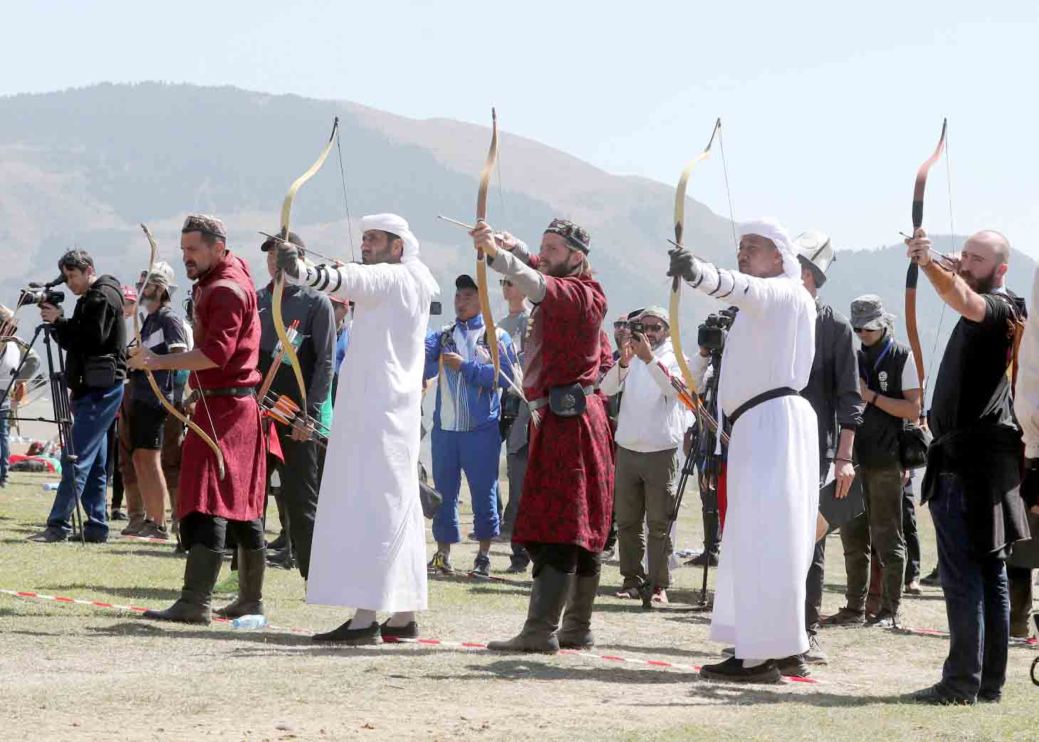 Celebrating heritage. Emirati and Kyrgyz archery contestants at the World Nomad Games in Kyrgyzstan.  (Abu Dhabi Festivals, Cultural and Heritage Programs Committee)