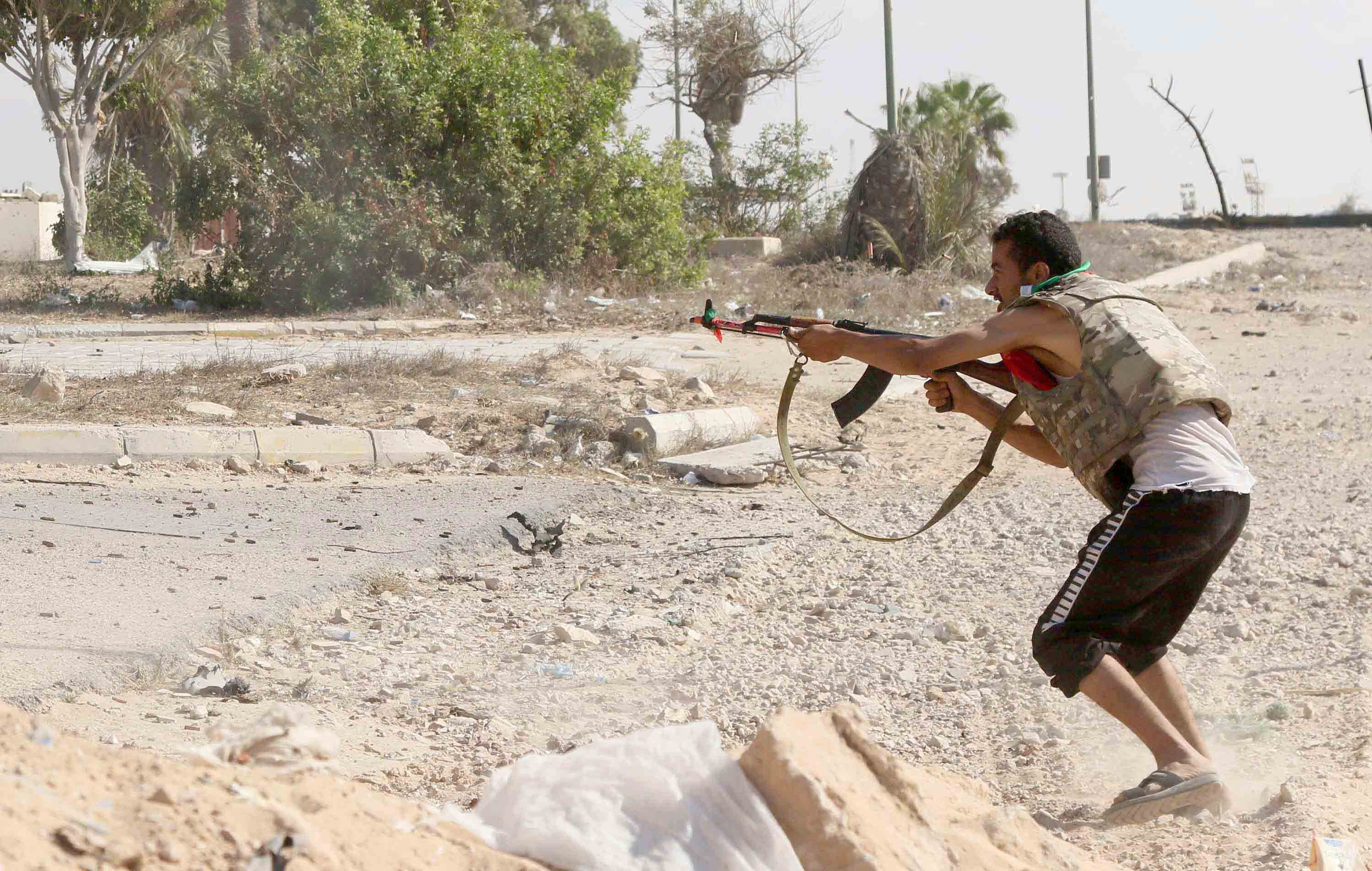 A file picture shows a militia fighter firing towards rival positions in western Sirte. (AFP)