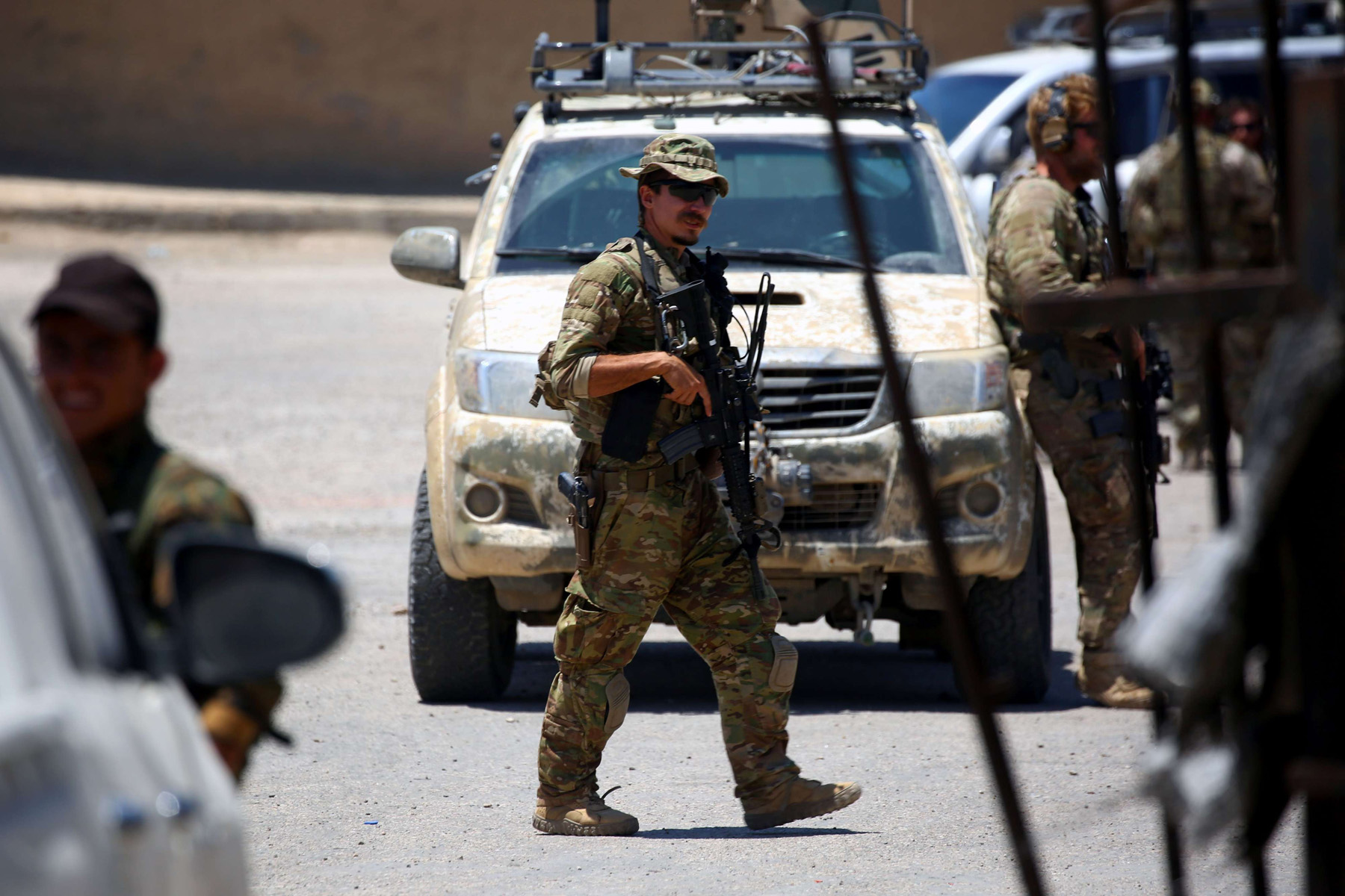 A file picture shows members of US forces standing guard in the town of Tabqa. (AFP)