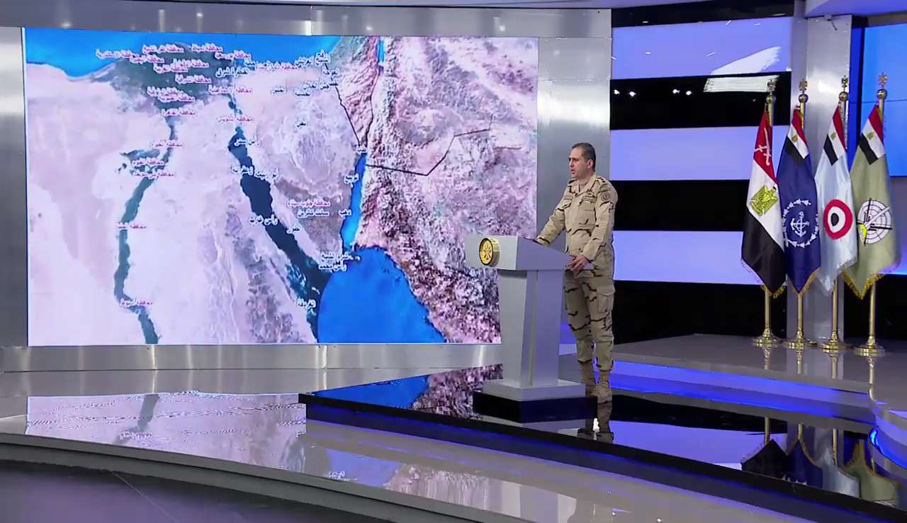 Watching the borders. Egypt's Army spokesman Colonel Tamer al-Rifai reads a statement next to a map of northern Egypt and the Sinai peninsula, last February.    (Egyptian Defence Ministry)