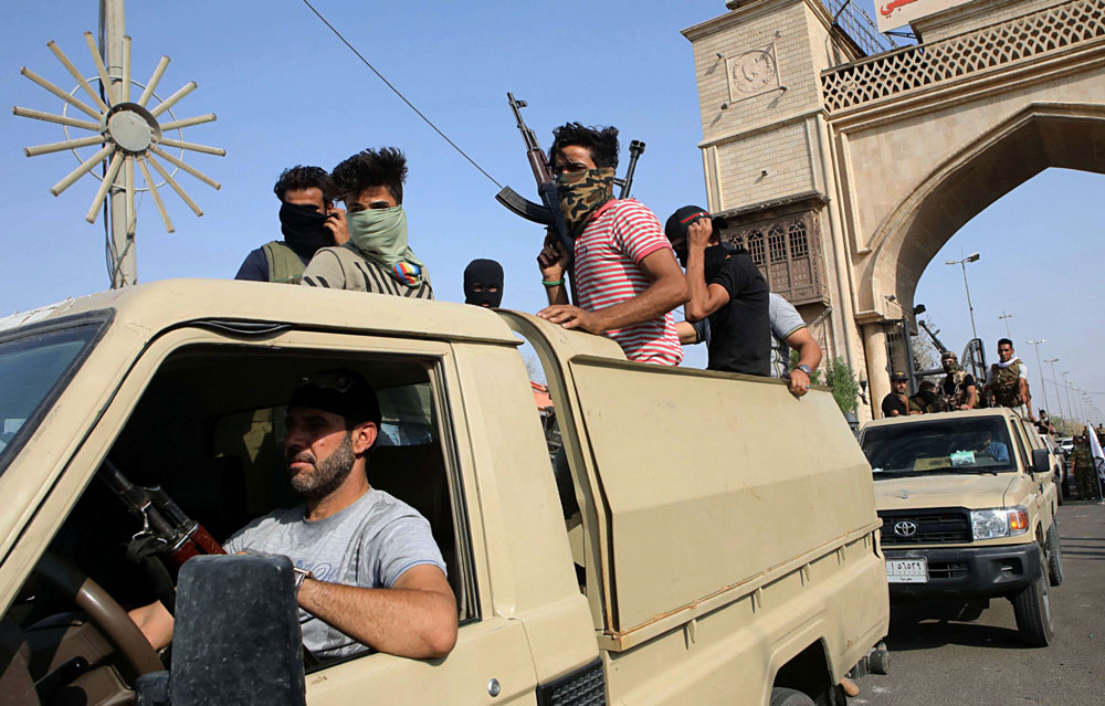 Members of Iran-backed Popular Mobilisation Forces parade in Basra, on September 8. (AP)