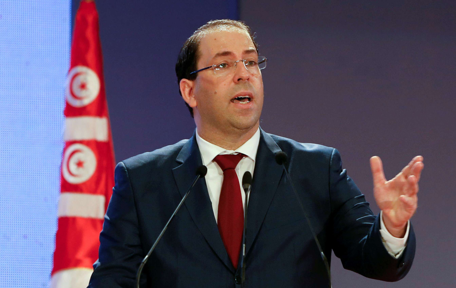 Tunisia's Prime Minister Youssef Chahed speaks during a national conference over 2019 budget in Tunis, Tunisia, September 14, 2018. (Reuters)