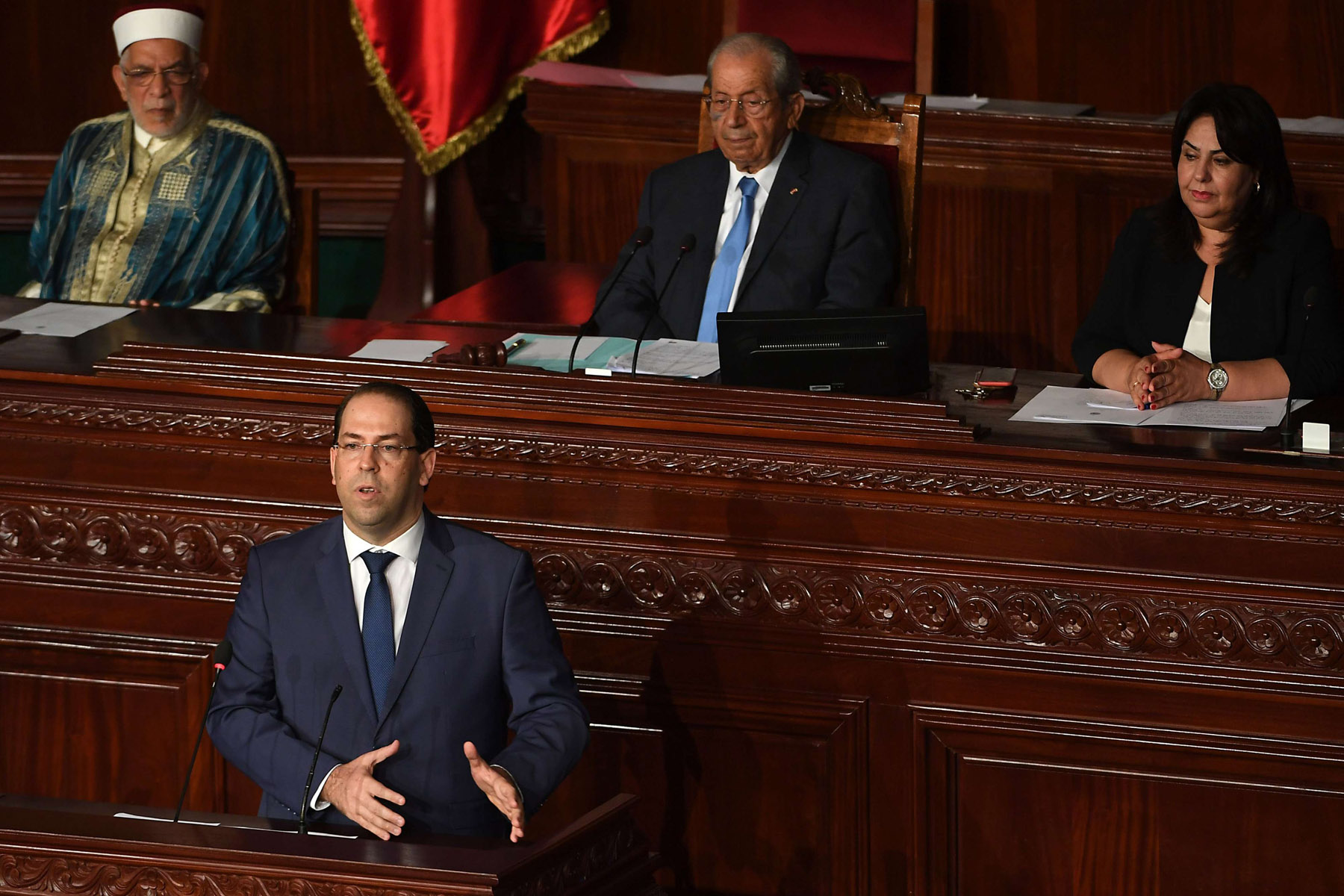 Tunisian Prime minister Youssef Chahed (2nd-L) gives a speech prior to a confidence bill during a plenary session at the Tunisian parliament in the capital Tunis on July 28, 2018. (AFP)
