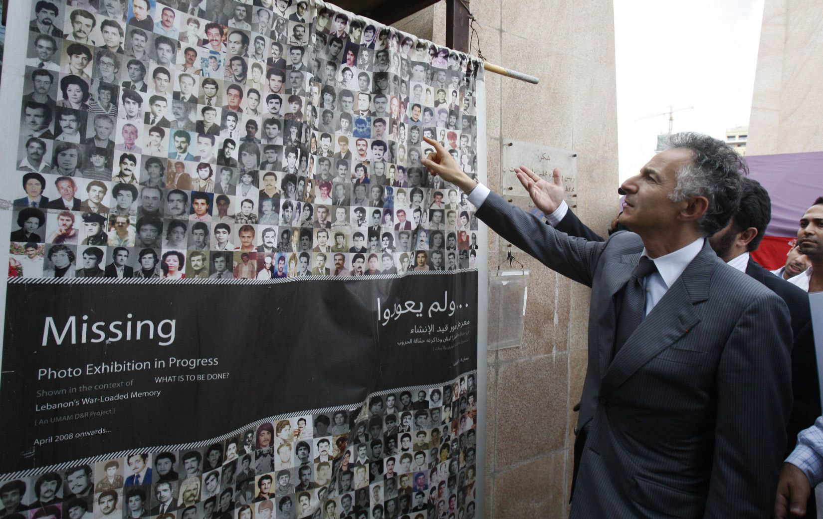 Scars of war. Francois Zimeray, France's top human rights official, looks at portraits of people who disappeared during Lebanon's civil war (1975-1990). (Reuters)