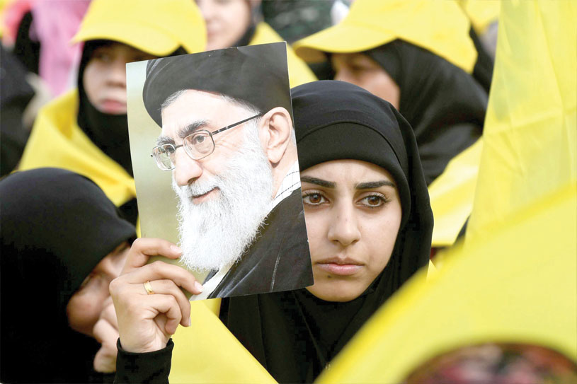 Proxy war. A Hezbollah supporter carries a picture of Iranian Supreme Leader Ayatollah Ali Khamenei during a rally in the Bekaa Valley, last May. (Reuters)