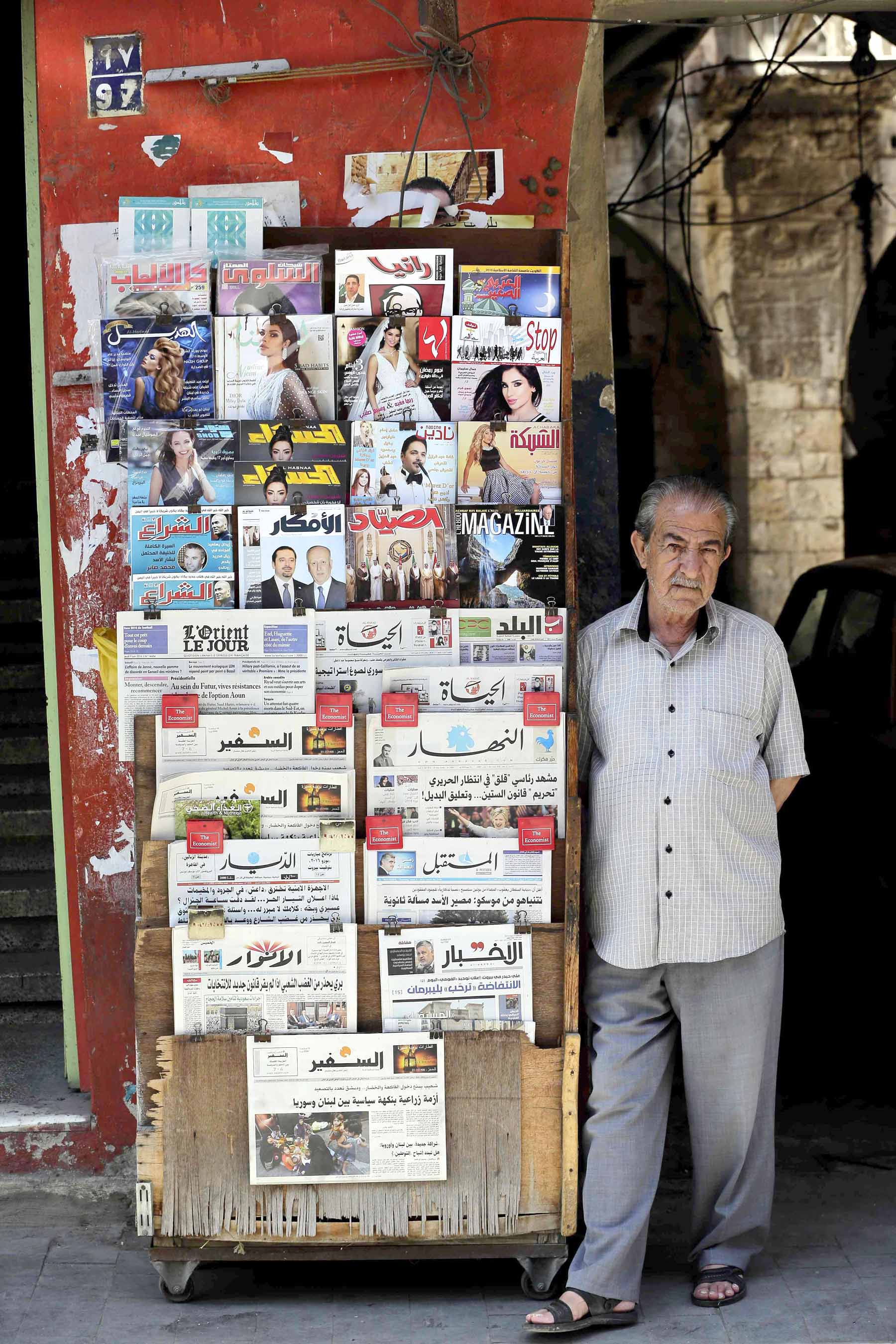 End of  journey.  A Lebanese vendor displays newspapers in the southern port city of Sidon.                       (AFP)