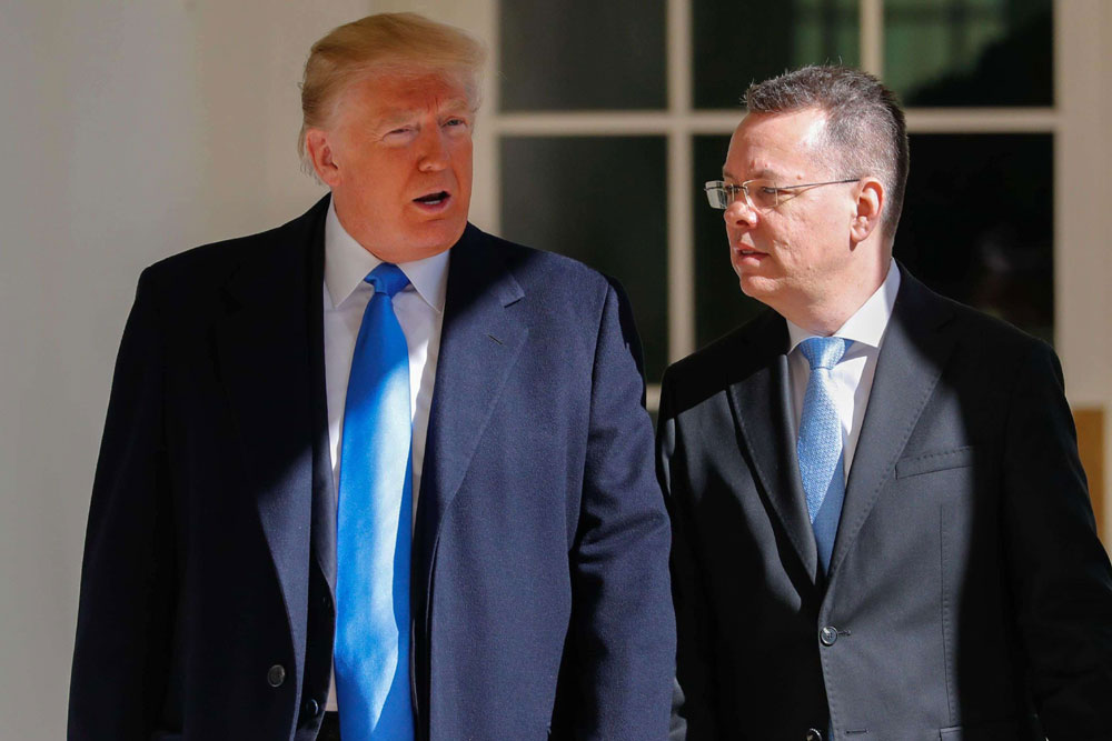 Freed US pastor Andrew Brunson (R) and US President Donald Trump before a meeting in the Oval Office at the White House in Washington, on October 13. (AFP)