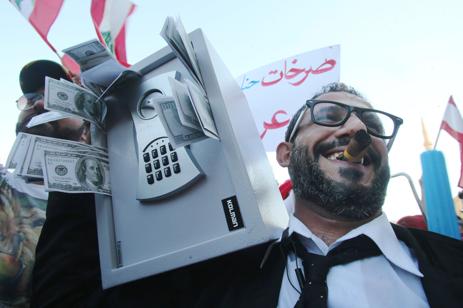 A file picture shows a Lebanese man holding a safe during a mass rally against corrupt politicians at the iconic Martyrs Square in Beirut. (AFP)