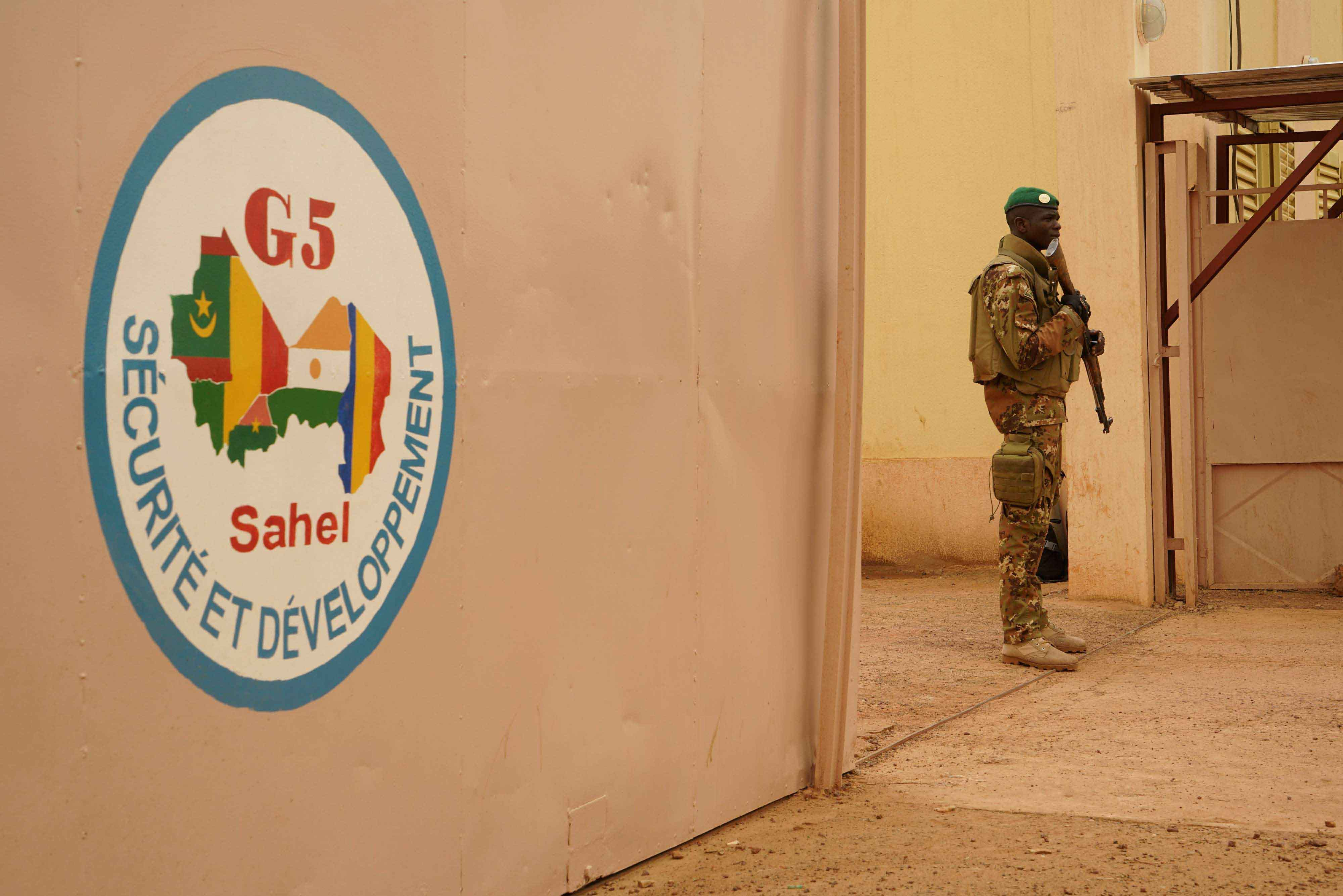 A Malian Army soldier stands guard at the entrance of the G5 Sahel headquarters in Sevare, Mali, last May. (AFP)