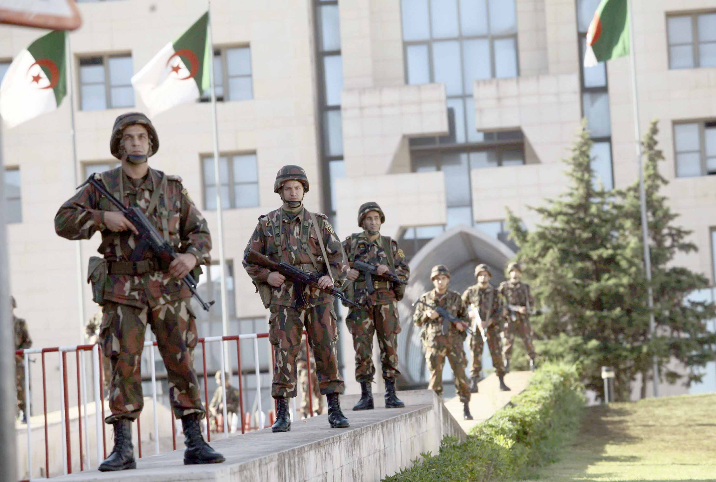Algerian republican forces stand guard in front of the Presidential Palace in Algiers. (Reuters)