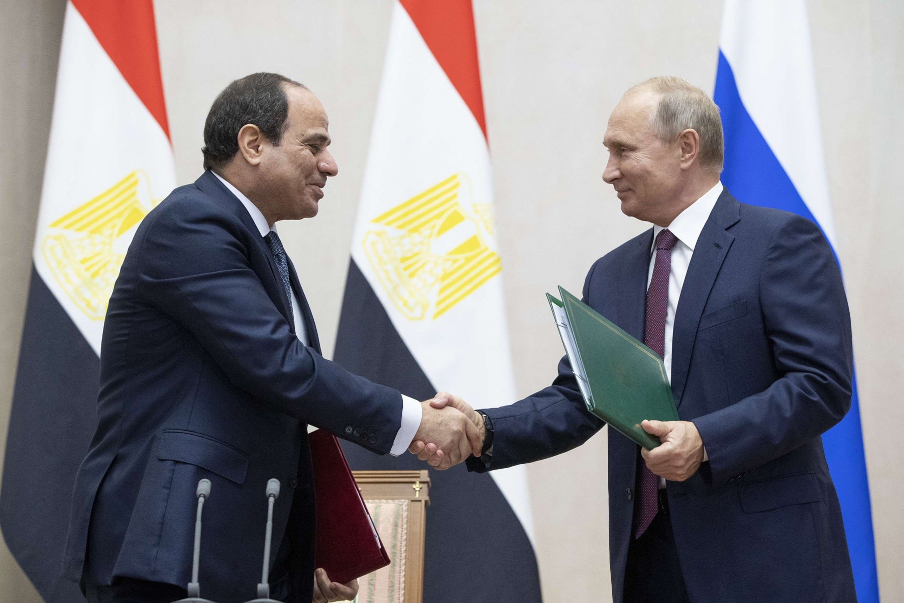 Russian President Vladimir Putin (R) and Egyptian President Abdel Fattah al-Sisi shake hands after a signing ceremony in Sochi, on October 17. (AP)