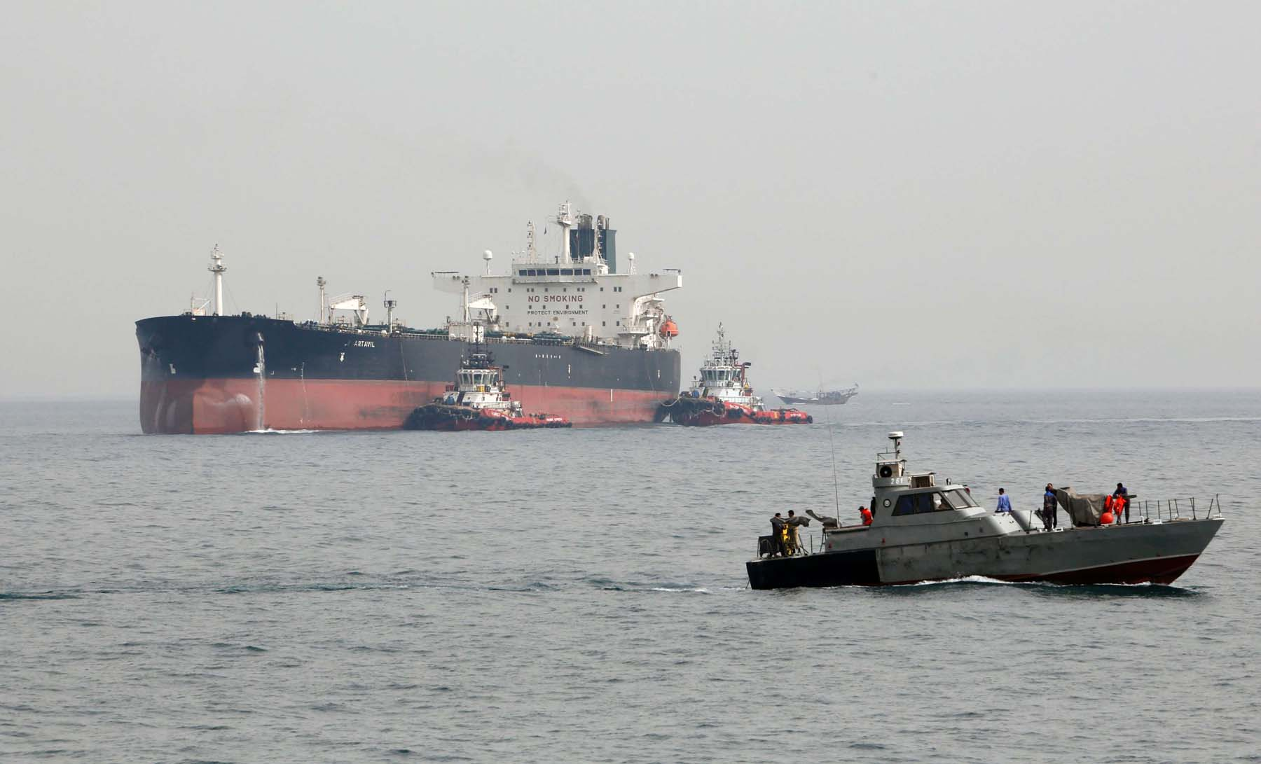 An Iranian military speedboat patrols the waters as a tanker perpares to dock at the oil facility in the Khark Island. (AFP)