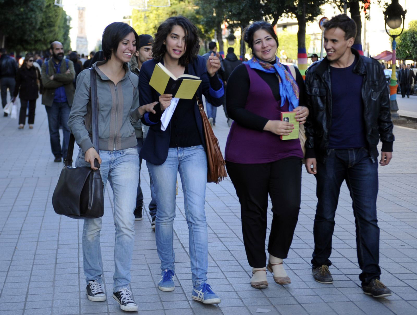 More than one language. Young Tunisians, some of them holding books, walk in the Avenue Habib Bourguiba in Tunis.   (AFP)