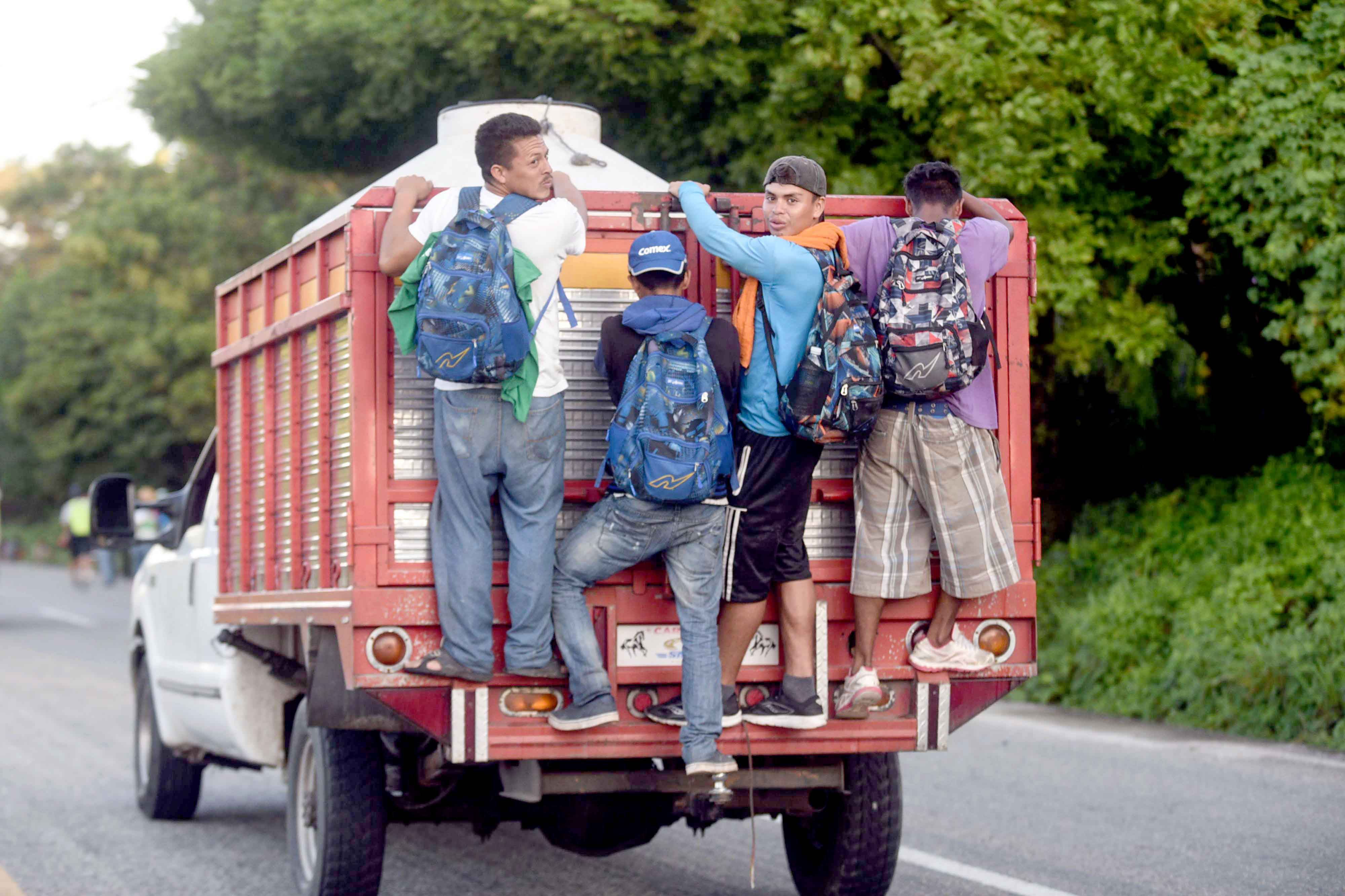 Free ride. Central American migrants hitch a ride as they head to the US southern border, on October 25. (AFP)