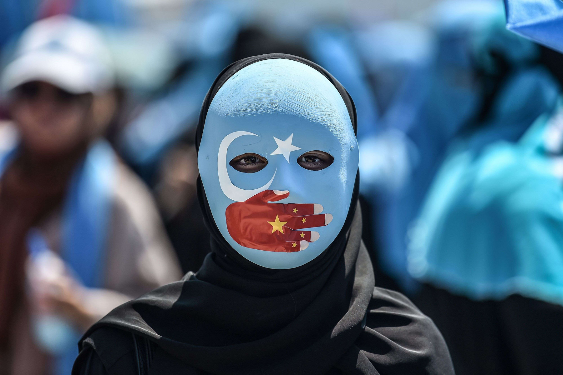 A supporter of the Muslim Uighur minority protests to denounce China's treatment of ethnic Uighurs in front of the Chinese consulate in Istanbul, last July 5. (AFP)