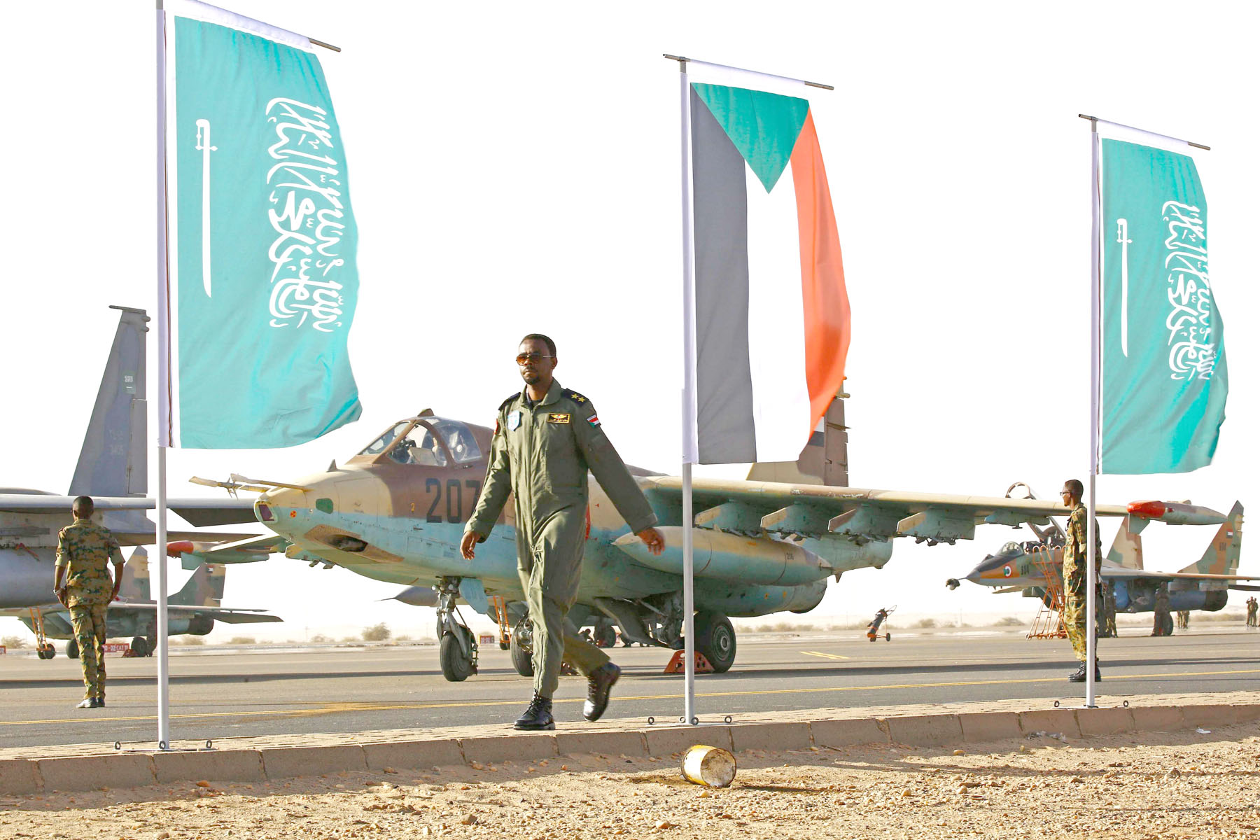 A member of Sudanese forces walks on the tarmac during a joint military drill with Saudi troops at the Marwa air base in Sudan. (AFP)