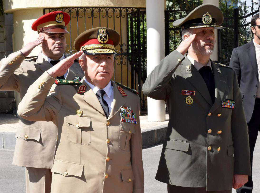 Iranian Defence Minister Amir Hatami (R) and his Syrian counterpart Abdullah Ayoub (L) in Damascus, last August. (SANA)