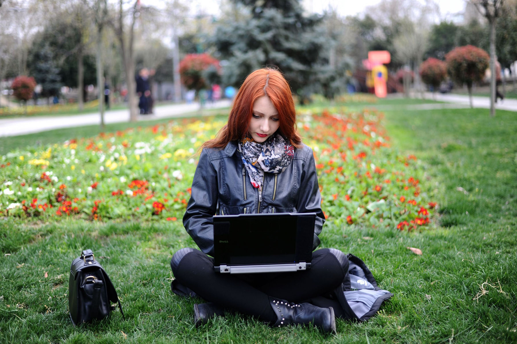 A woman uses her laptop in Istanbul. (AFP)