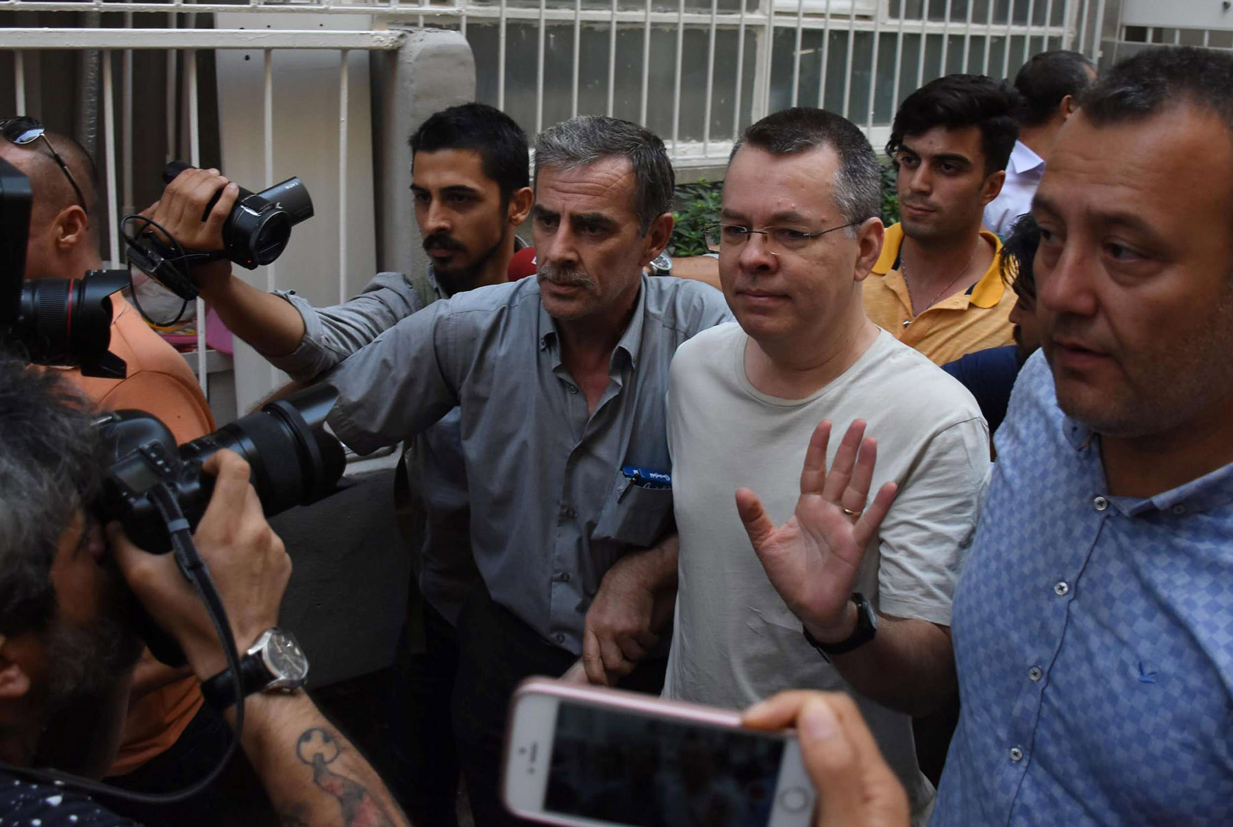 US pastor Andrew Brunson (C-R) arrives at his home after being released from prison in Izmir, last July. (Reuters)