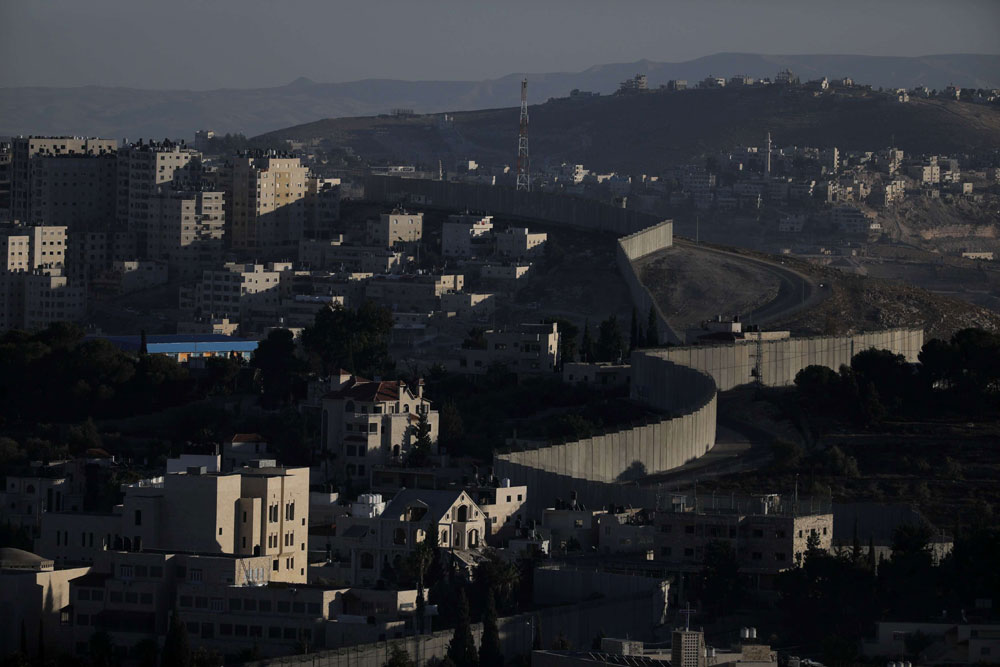 A general view shows the Israeli barrier at the Palestinian town of Abu Dis in the West Bank east of Jerusalem. (Reuters)