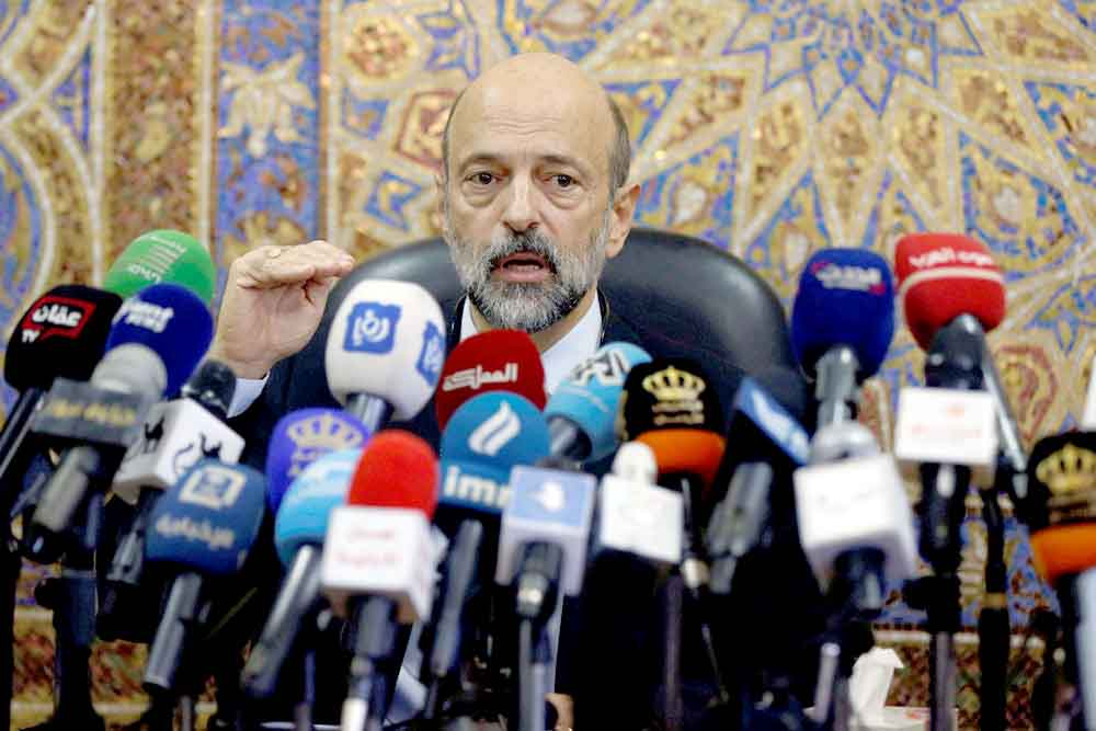 Jordanian Prime Minister Omar Razzaz speaks during a news conference in Amman, last June. (Reuters)