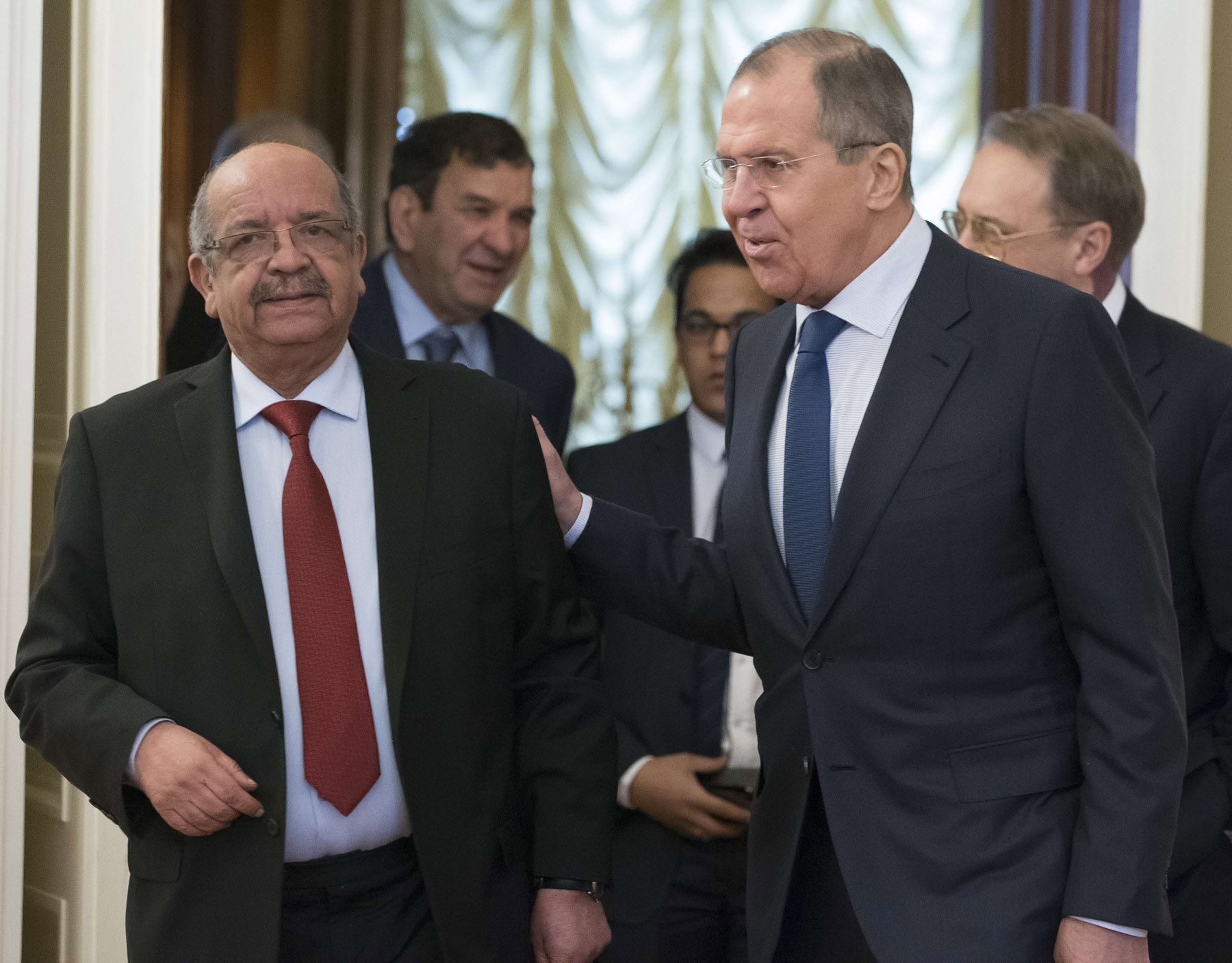 Russian Foreign Minister Sergey Lavrov, right, and Algerian Foreign Affairs Minister Abdelkader Messahel enter a hall for their talks in Moscow, Russia, Monday, Feb. 19, 2018. (AP)