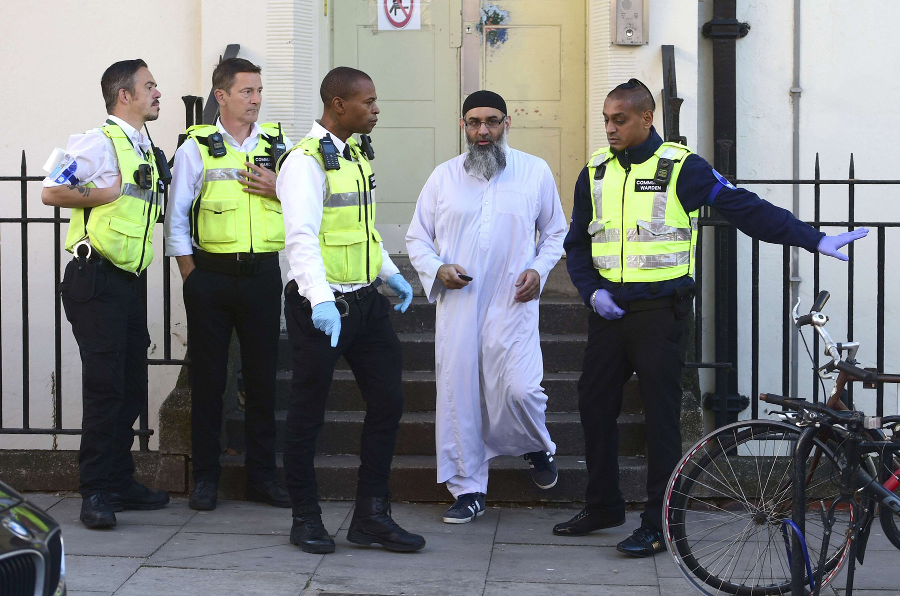 Anjem Choudary leaves a bail hostel in north London after his release from Belmarsh Prison, Friday October 19, 2018. (AP)