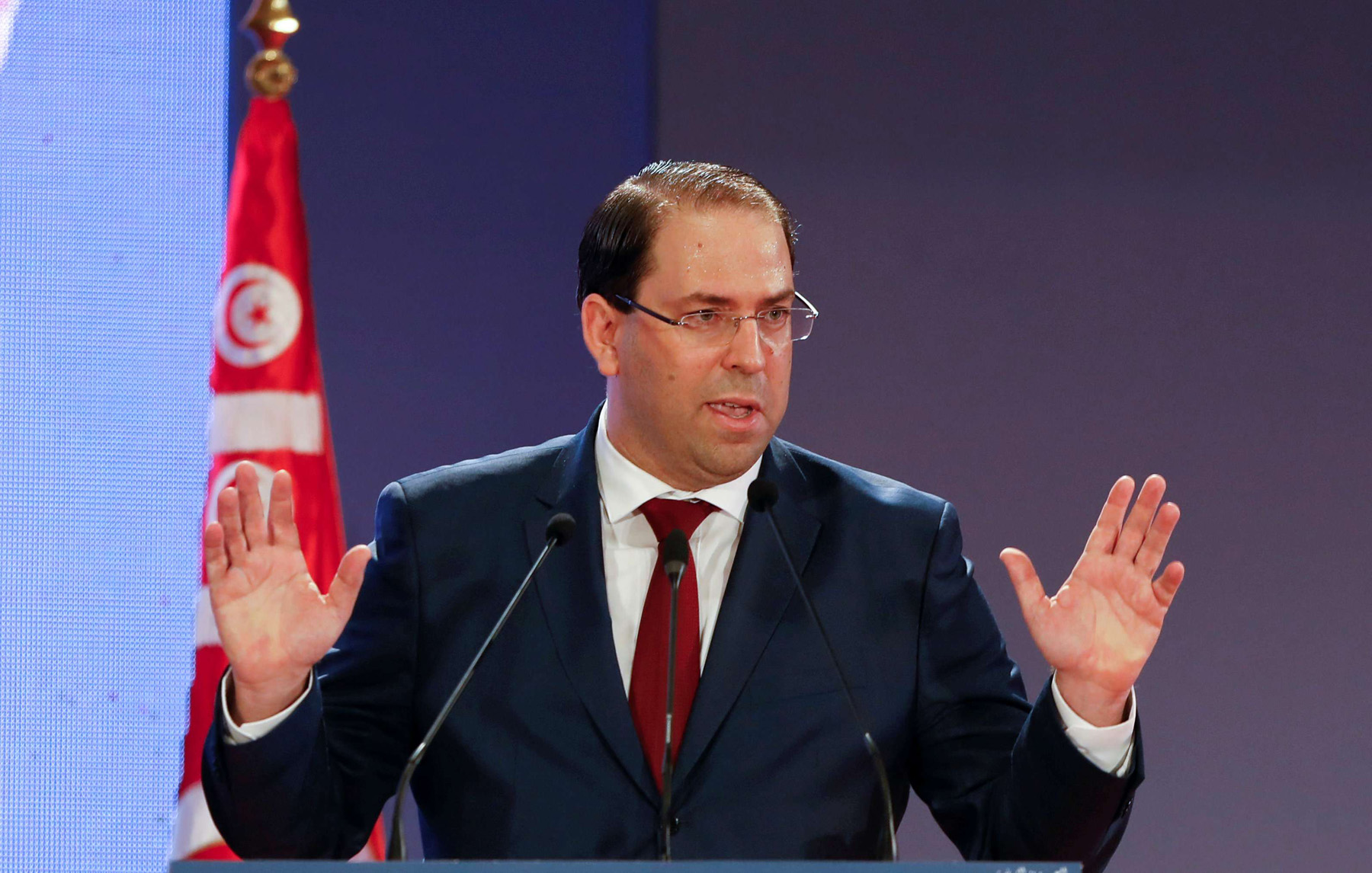 Tunisian Prime Minister Youssef Chahed gestures as he speaks during a national conference over 2019 budget in Tunis, Tunisia, September 14, 2018. (Reuters)