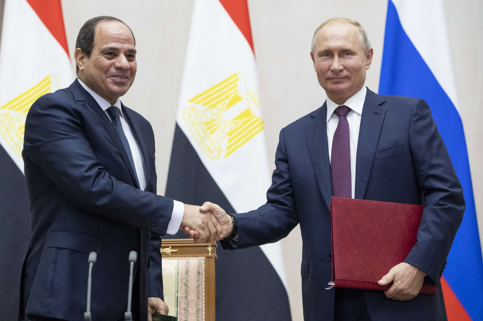Russian President Vladimir Putin, right, and Egyptian President Abdel-Fattah el-Sisi shake hands after a signing ceremony following their talks in Sochi, Russia, Wednesday, October 17, 2018. (AP)