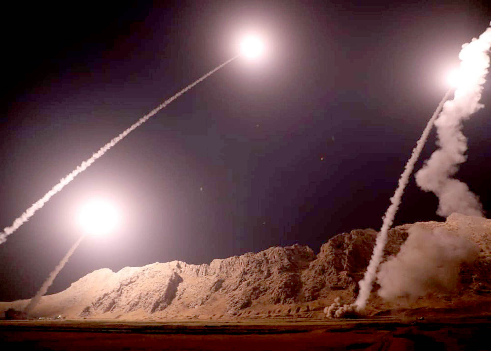 Missiles are fired from Kermanshah in western Iran to target positions of the Islamic State group in Syria, on October 1. (Islamic Revolutionary Guard Corps)