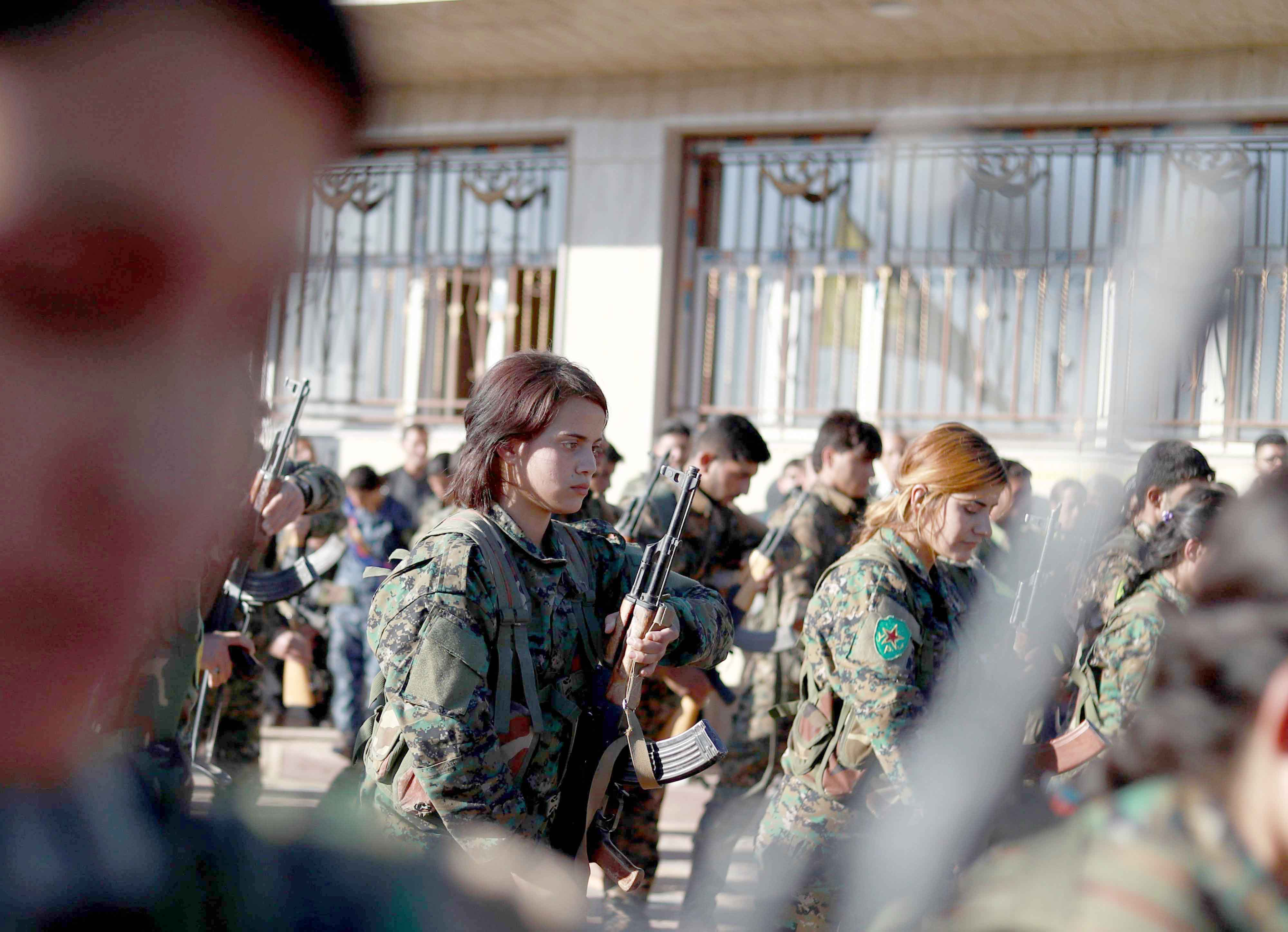 Fighters from the Syrian Democratic Forces attend the funeral of one of their commanders in the Kurdish-controlled city of Qamishly, on October 29. (AFP)