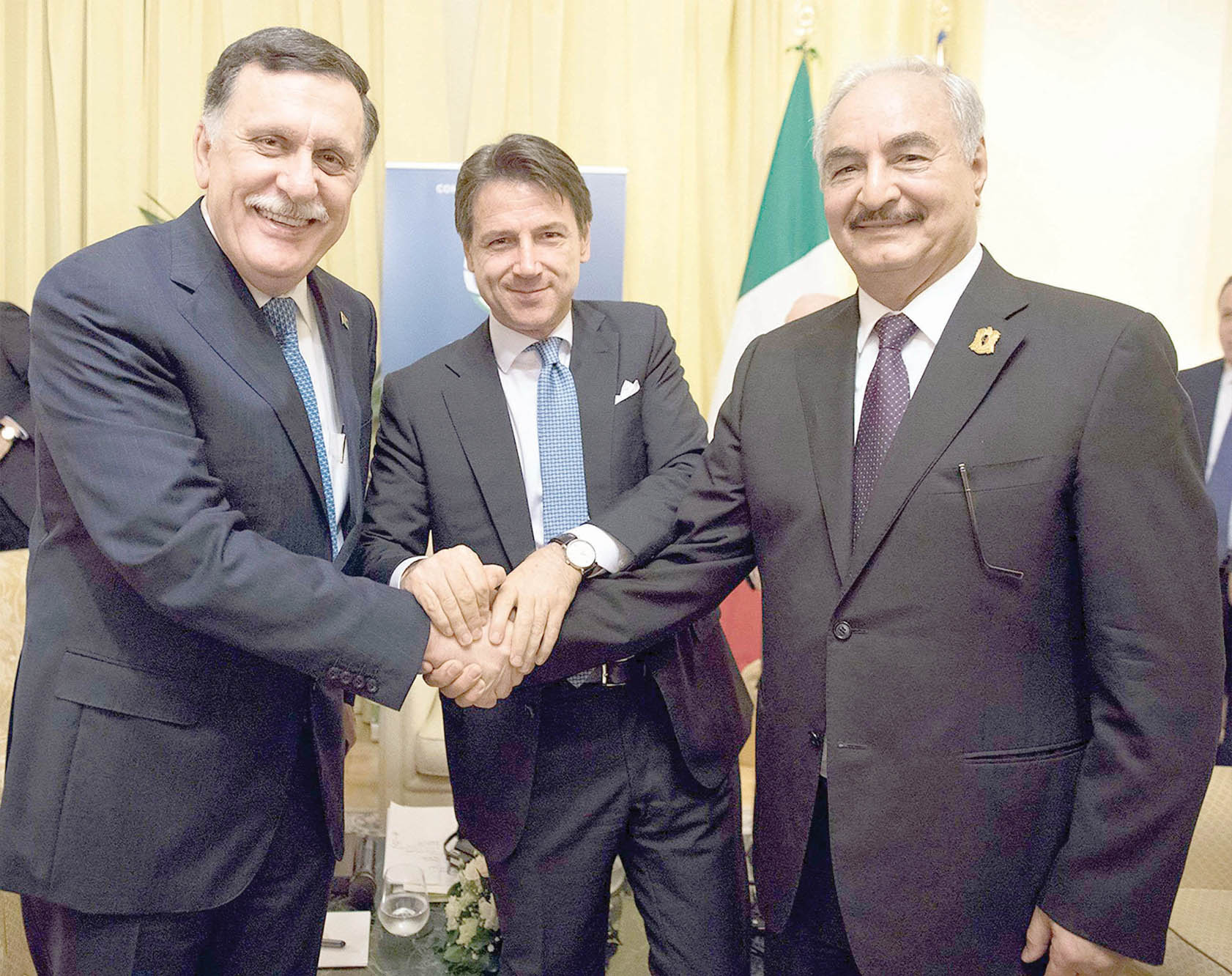 Italian Prime Minister Giuseppe Conte (C) poses with Chairman of the Presidential Council of Libya Fayez al-Sarraj (L) and Libyan Field-Marshal Khalifa Haftar on the sidelines of the Palermo conference, on November 13. (Italian Prime Minister's Press Office)