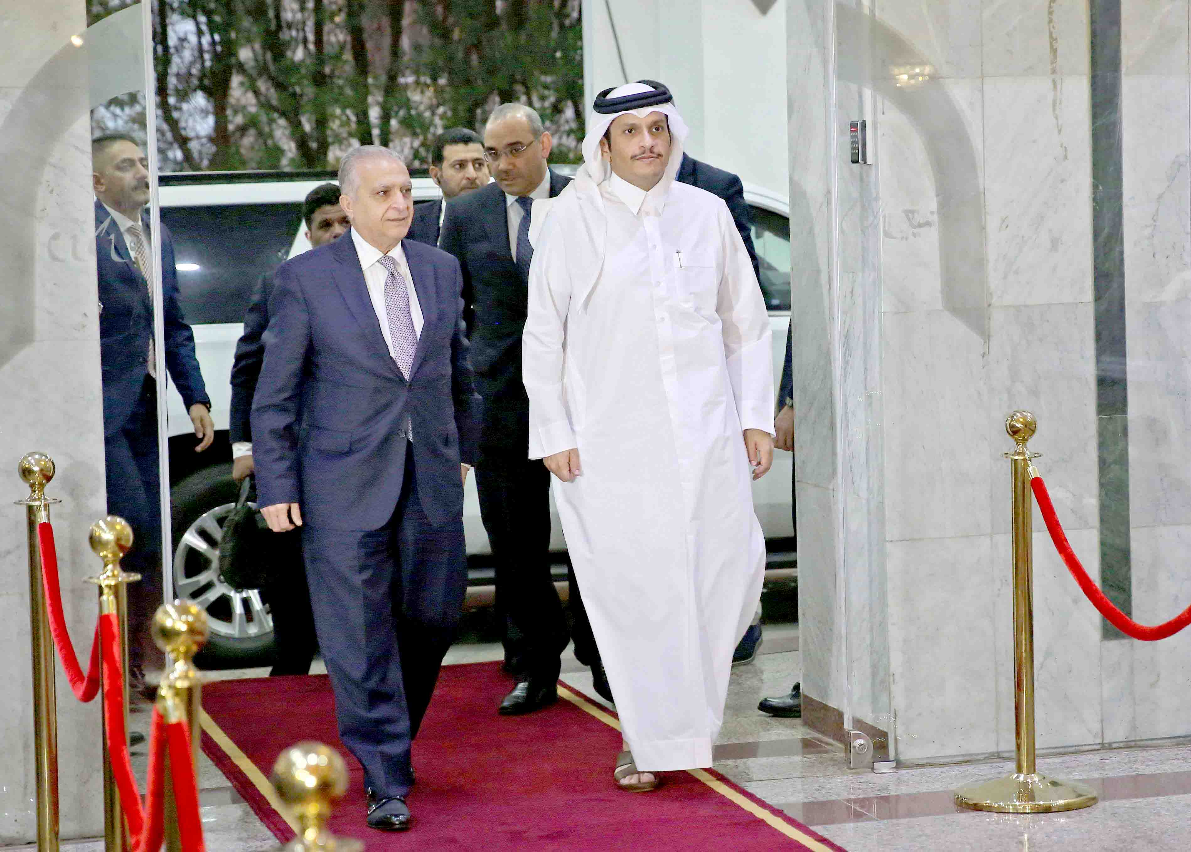 Wrong steps. Iraq's Foreign Minister Mohamed Ali Alhakim (L) walks with Qatar's Foreign Minister Sheikh Mohammed bin Abdulrahman bin Jassim al-Thani in Baghdad, on November 7. (Reuters)