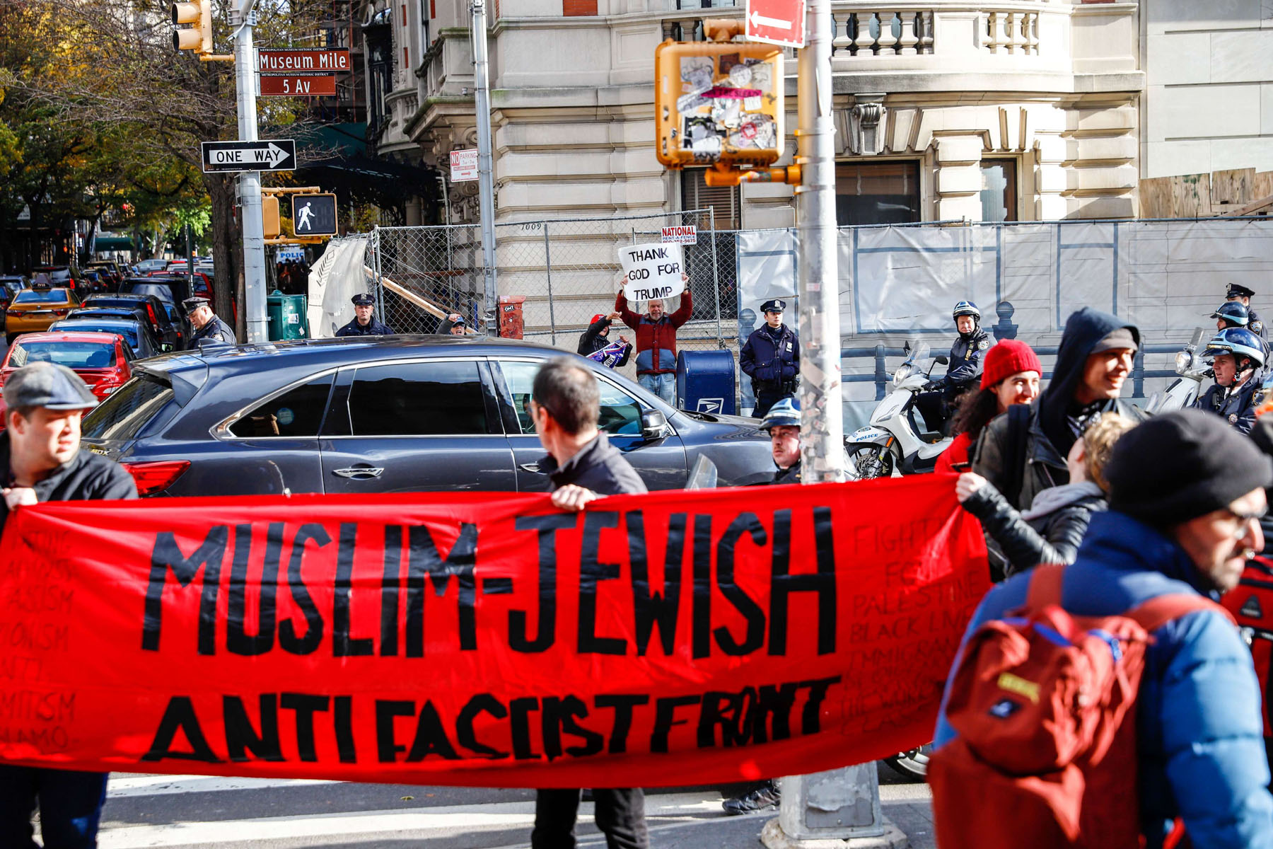 People hold banners and placards during a protest against fascism and anti-Semitism in New York, on November 10.  (William Volcov)