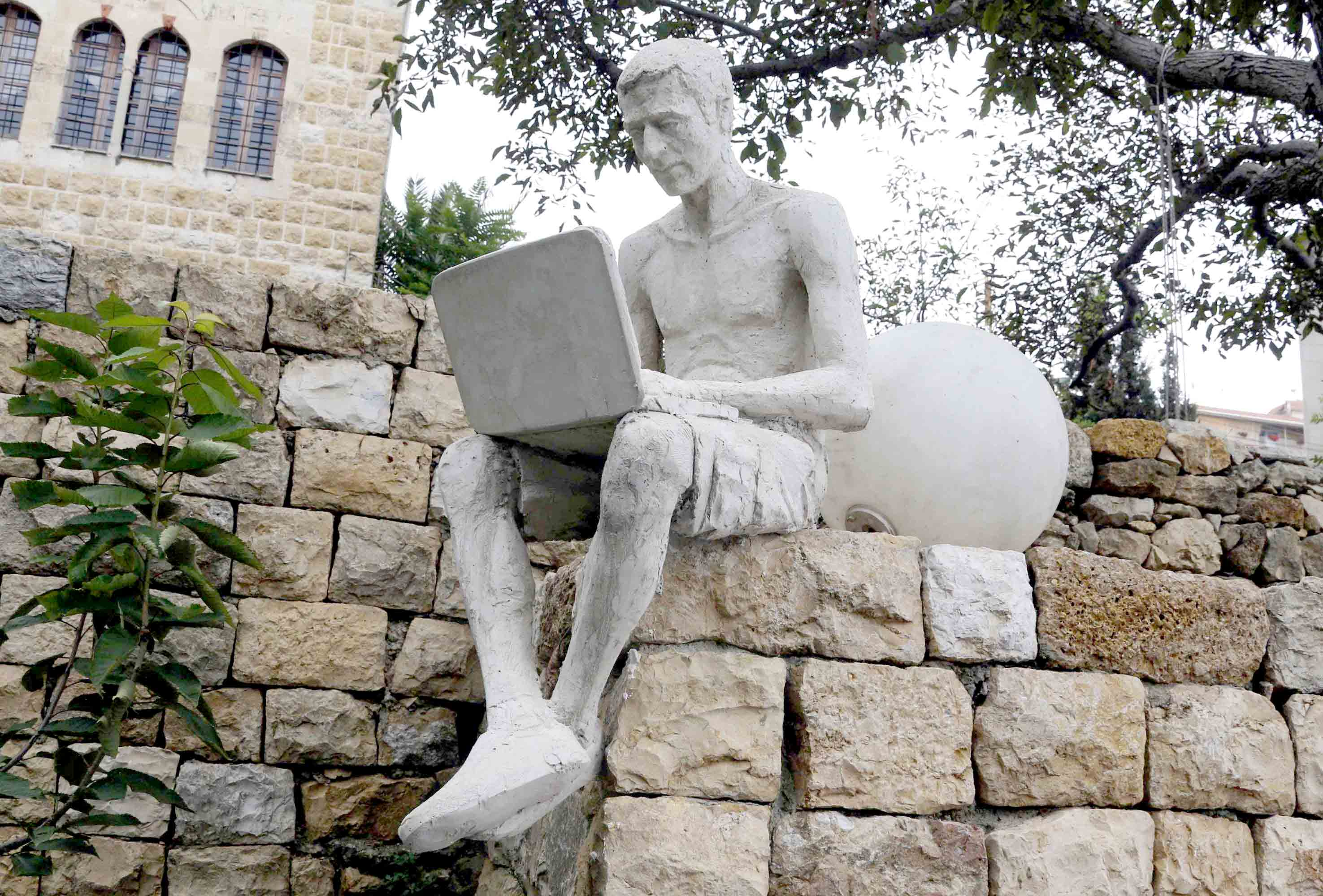 A sculpture of a man with a laptop by Syrian artist Wissam Muases at the Art Residency Aley in eastern Lebanon. (Reuters)