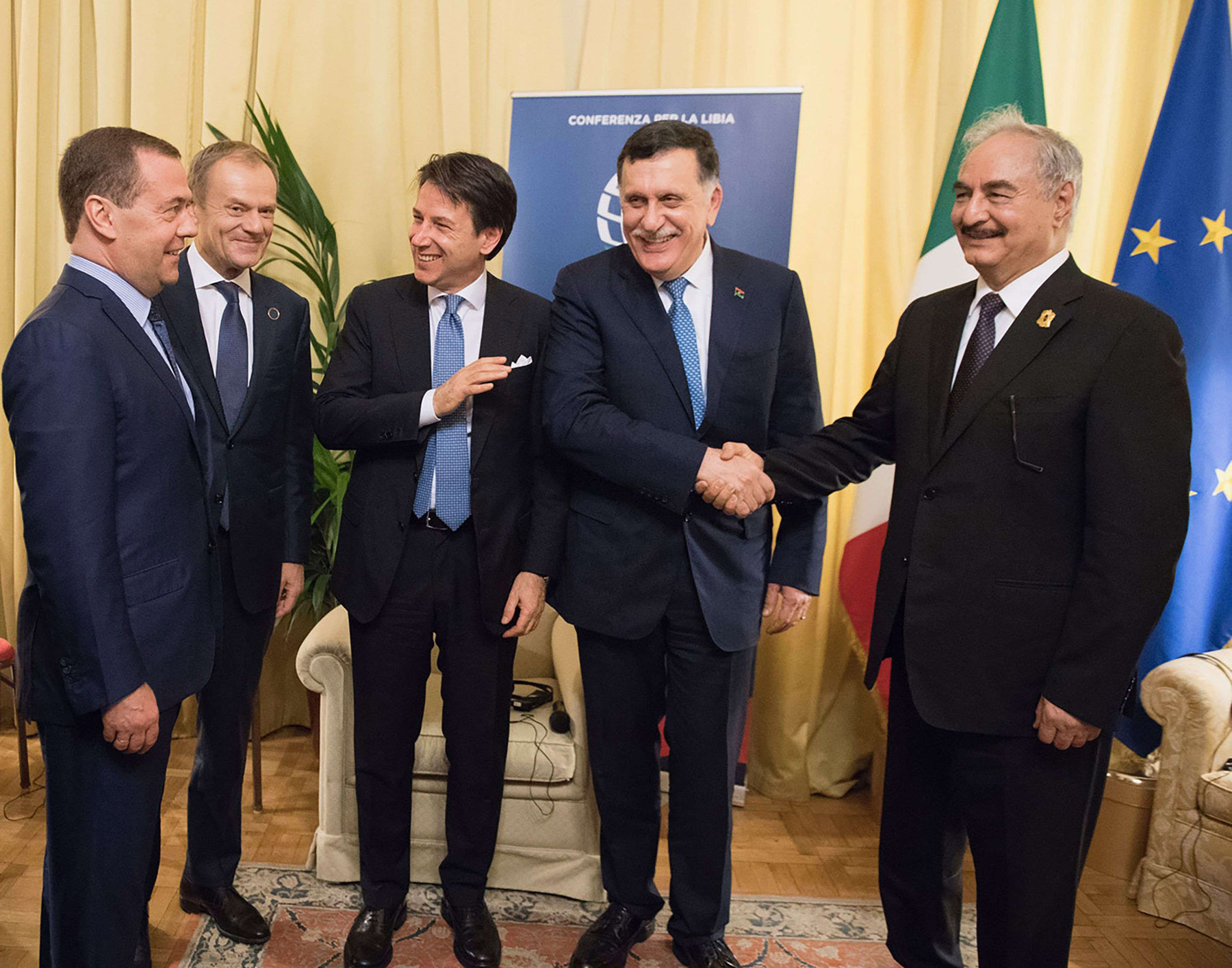 (L-R) Russian Prime Minister Dmitry Medvedev, EU President Donald Tusk, Italian Prime Minister Giuseppe Conte, Chairman of the Presidential Council of Libya Fayez al-Sarraj and Libyan Field-Marshal Khalifa Haftar meet on the sidelines of the Palermo conference, on November 13. (Italian Prime Minister's Press Office)
