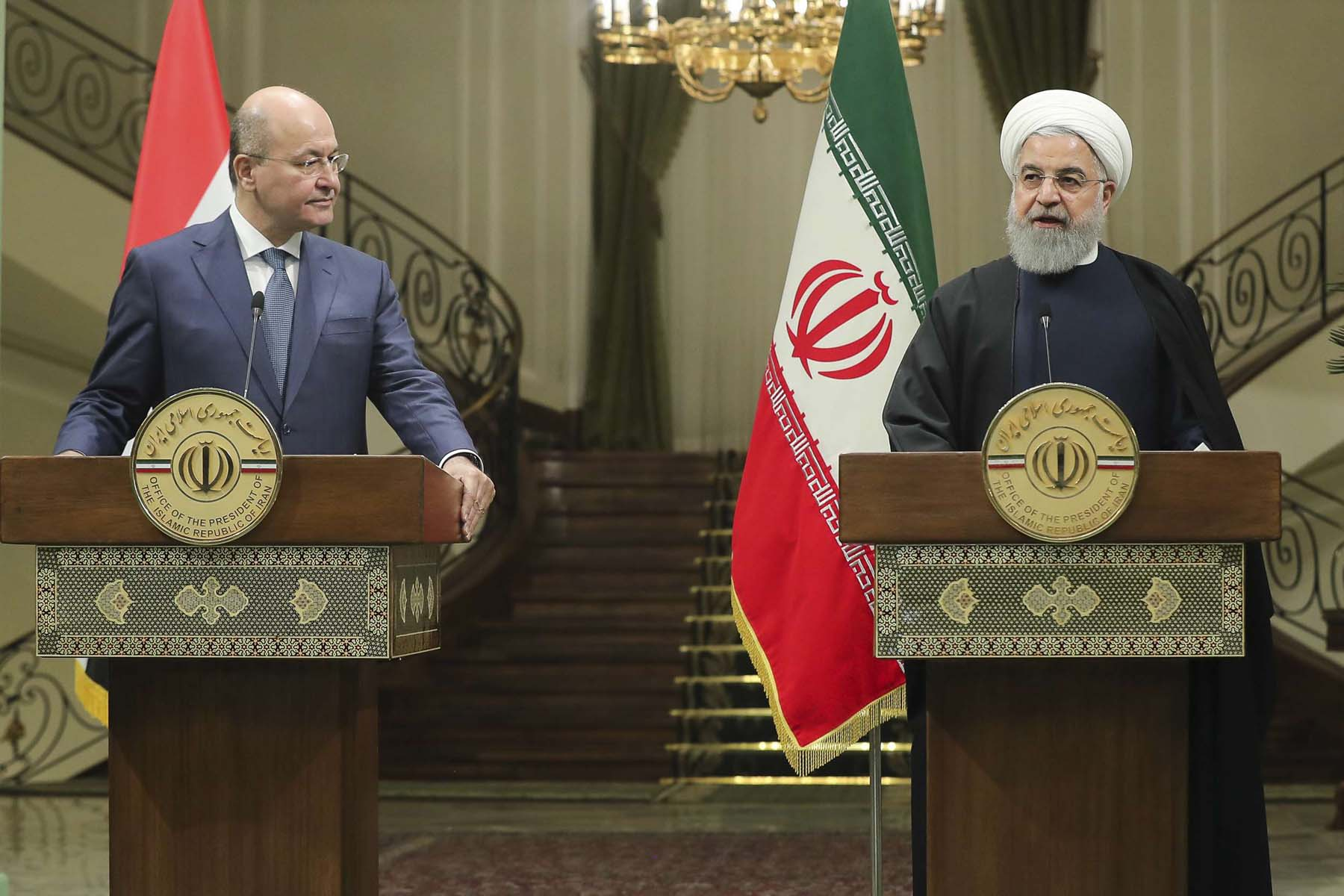 Iranian President Hassan Rohani (R) speaks during a joint news conference with his Iraqi counterpart Barham Salih at the Saadabad Palace in Tehran, on November 17. (Iranian Presidency)