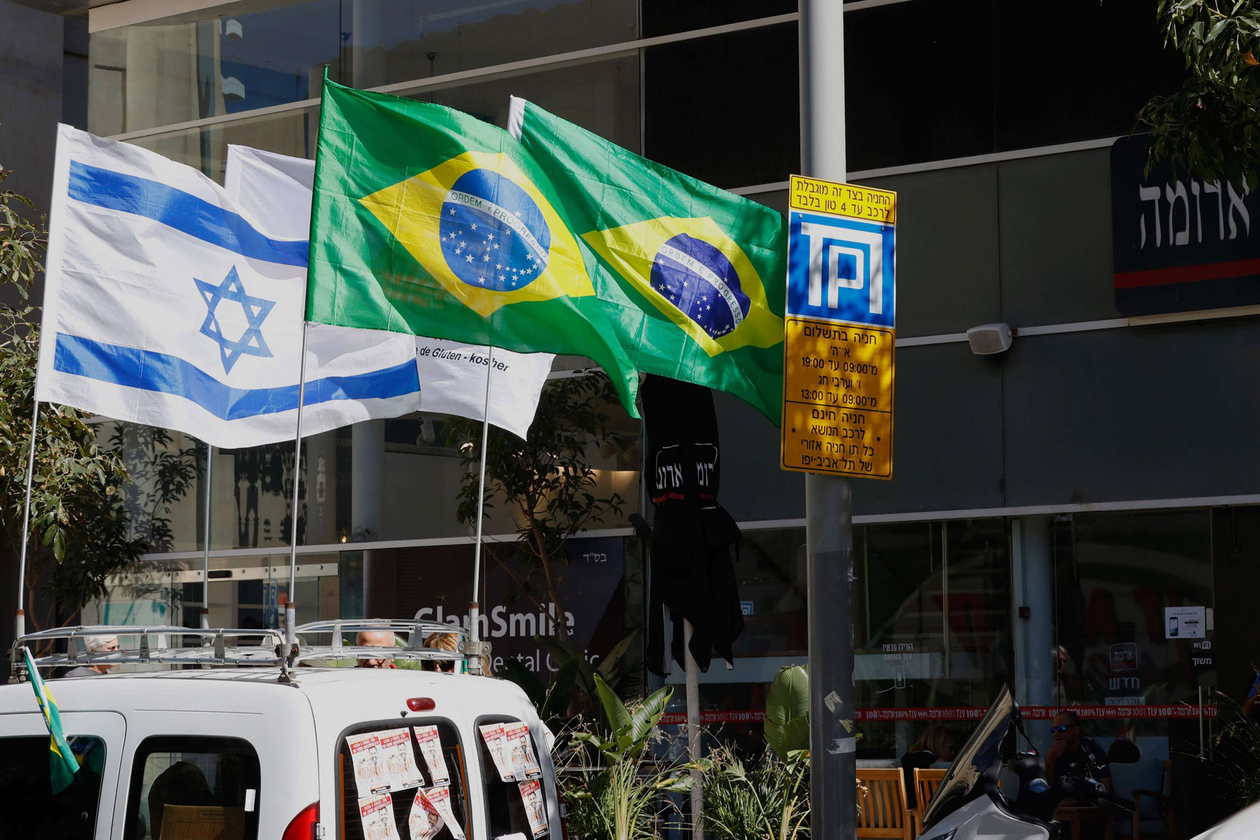 Fresh blow. Israeli and Brazilian flags hang outside the building housing the offices of the Brazilian Embassy in Tel Aviv.                         (AFP)